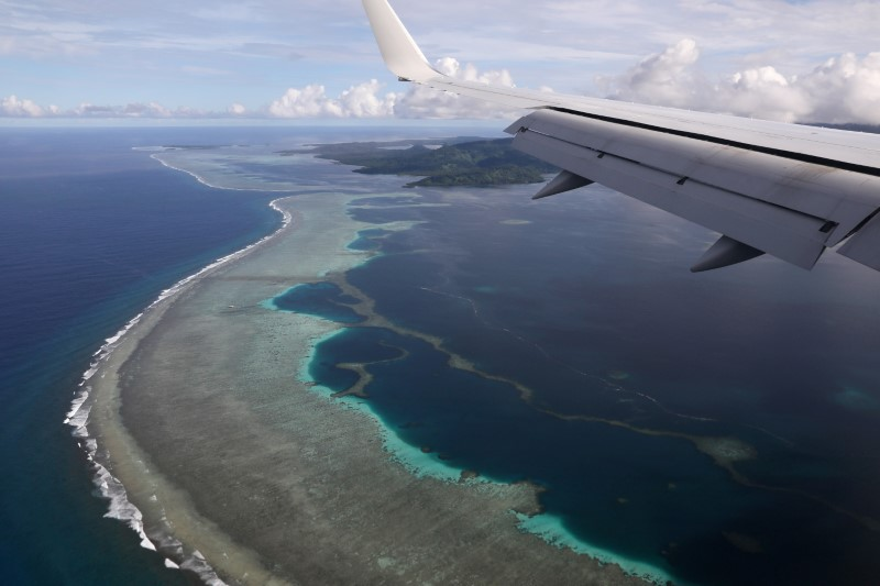Plane carrying then U.S. Secretary of State Mike Pompeo makes its landing approach on Pohnpei International Airport in Kolonia, Federated States of Micronesia August 5, 2019. REUTERS/Jonathan Ernst/File Photo
