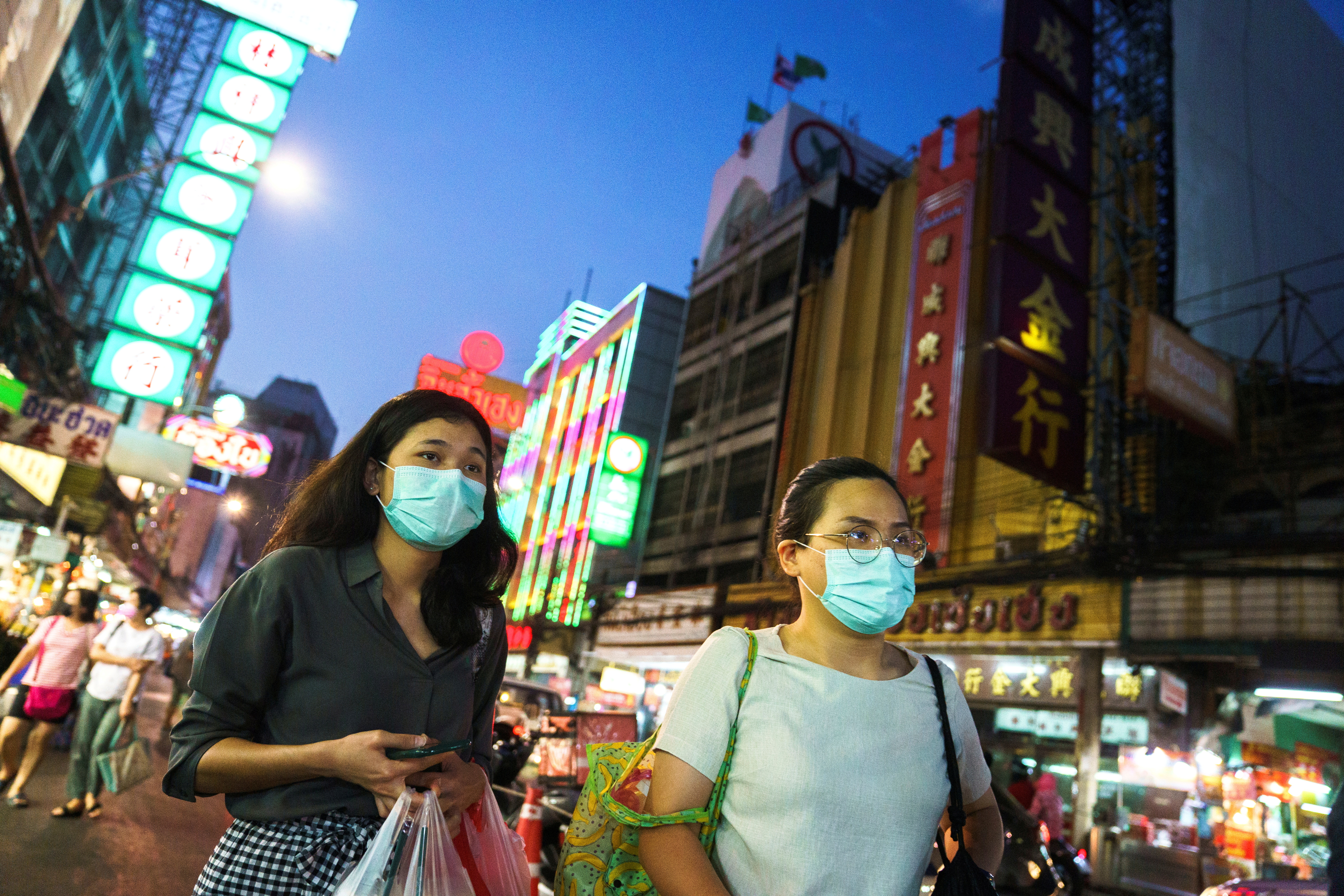 People wearing face masks shop for street food in Chinatown amid the spread of the coronavirus disease (COVID-19) in Bangkok, Thailand, January 6, 2021. REUTERS/Athit Perawongmetha/File Photo