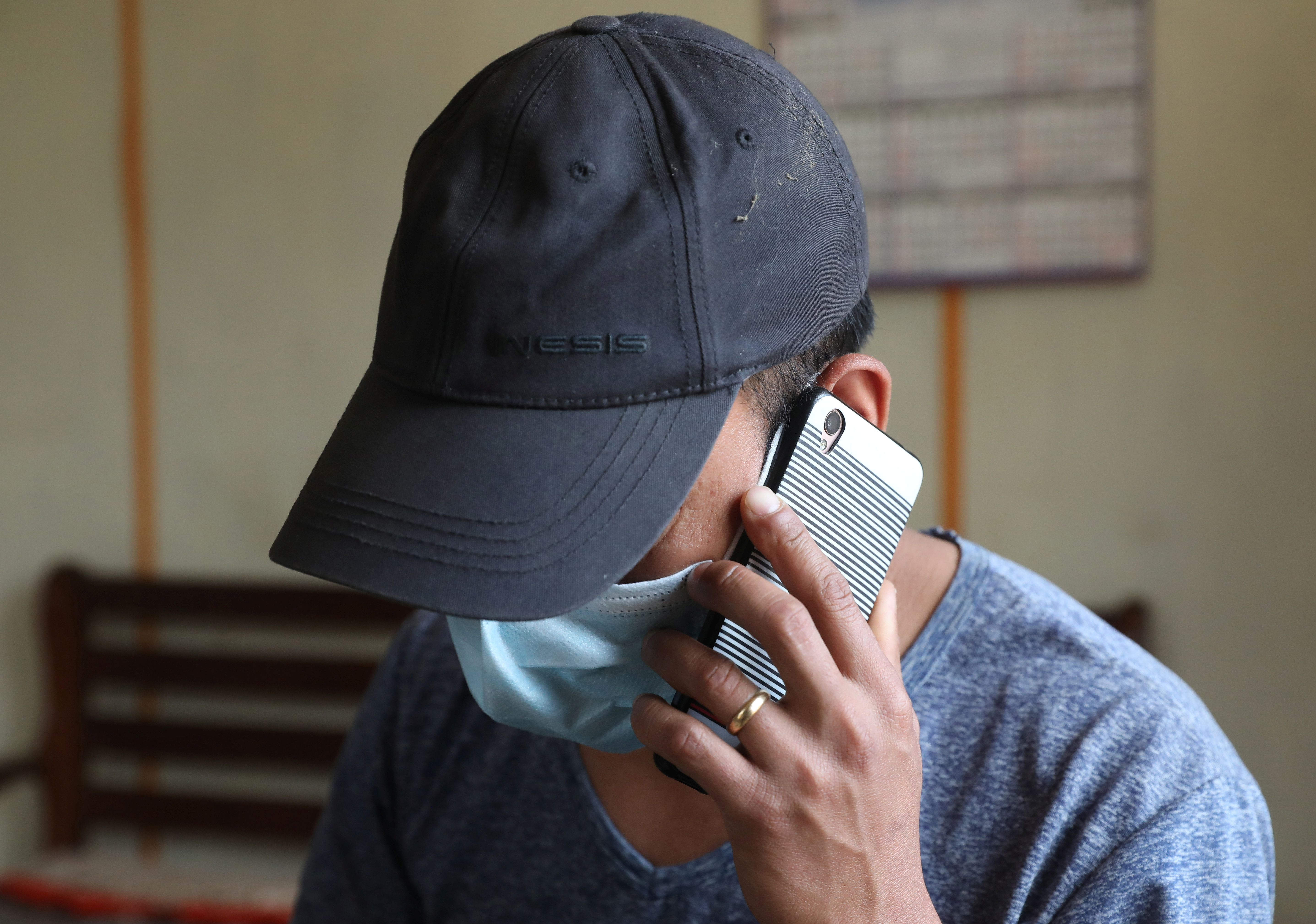 A Myanmar national who said he was a policeman and recently fled to India speaks on his mobile phone at an undisclosed location in India's northeastern state of Mizoram, near the India-Myanmar border, March 15, 2021.