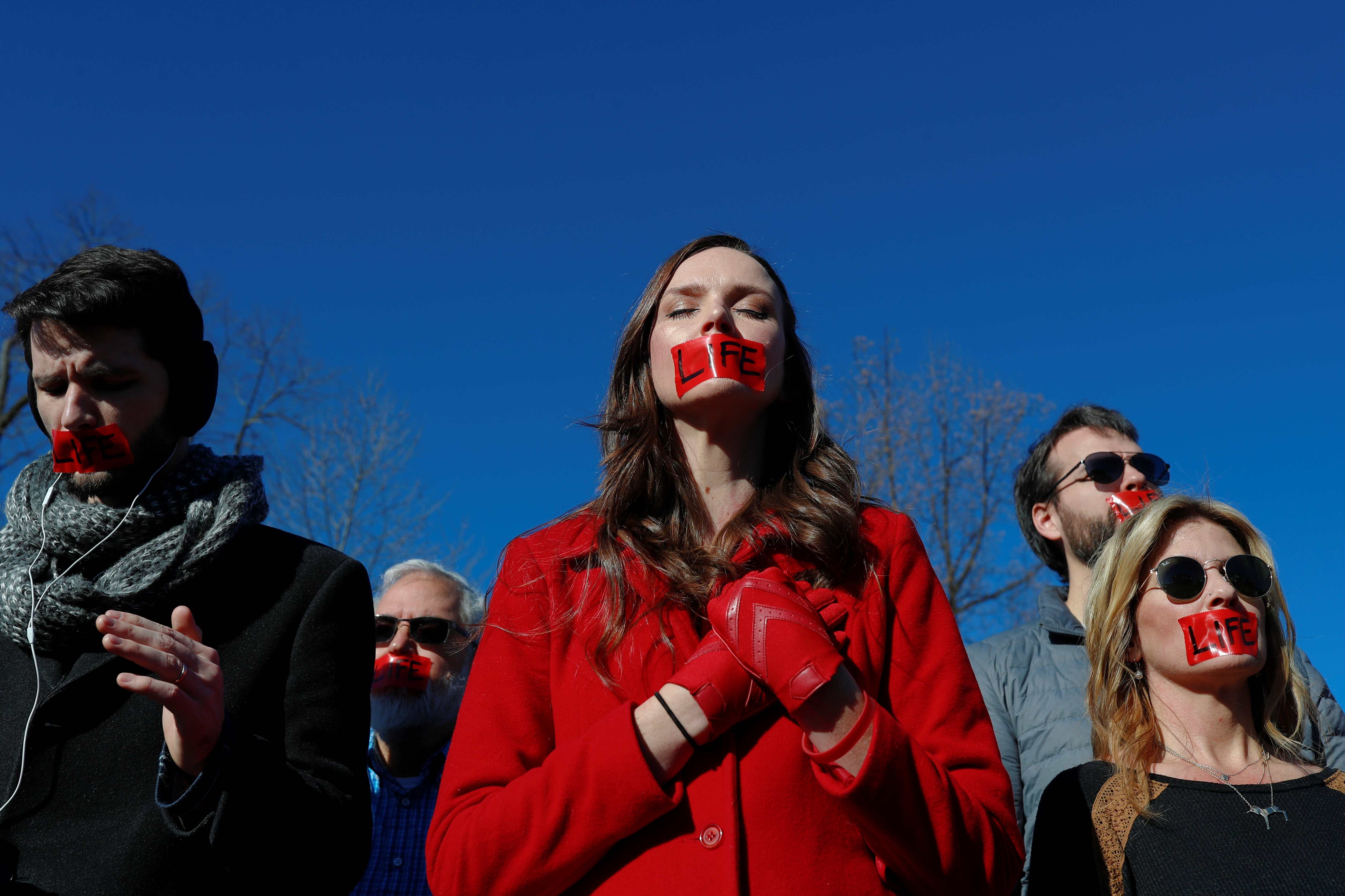 Pro-life demonstrators stand in silence outside of the U.S. Supreme Court as justices hear a major abortion case on the legality of a Republican-backed Louisiana law that imposes restrictions on abortion doctors, on Capitol Hill in Washington, U.S., March 4, 2020.  REUTERS/Tom Brenner