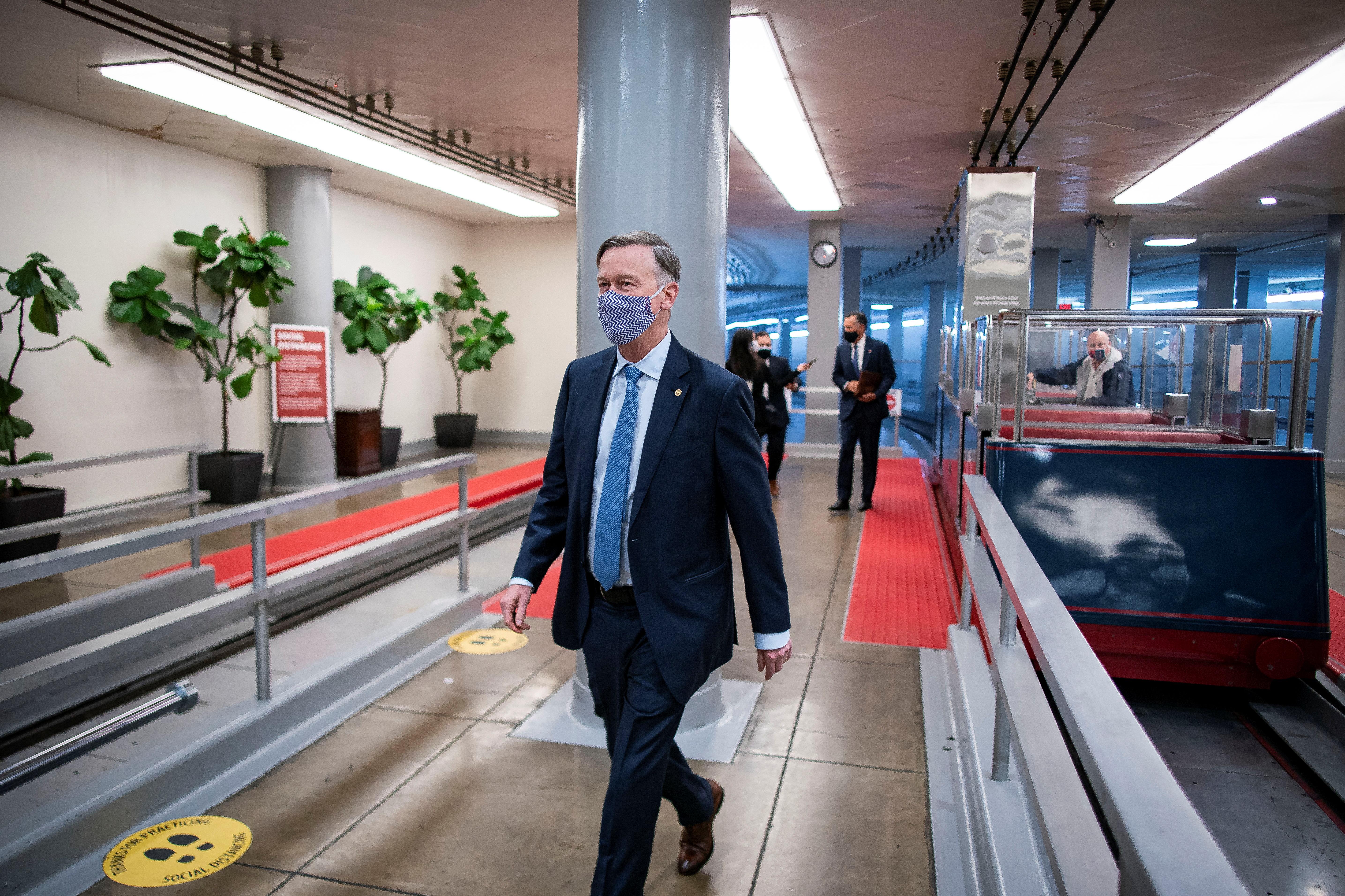 U.S. Senator John Hickenlooper (D-CO) arrives for a vote in the basement of the U.S. Capitol in Washington, U.S., January 26, 2021. REUTERS/Al Drago
