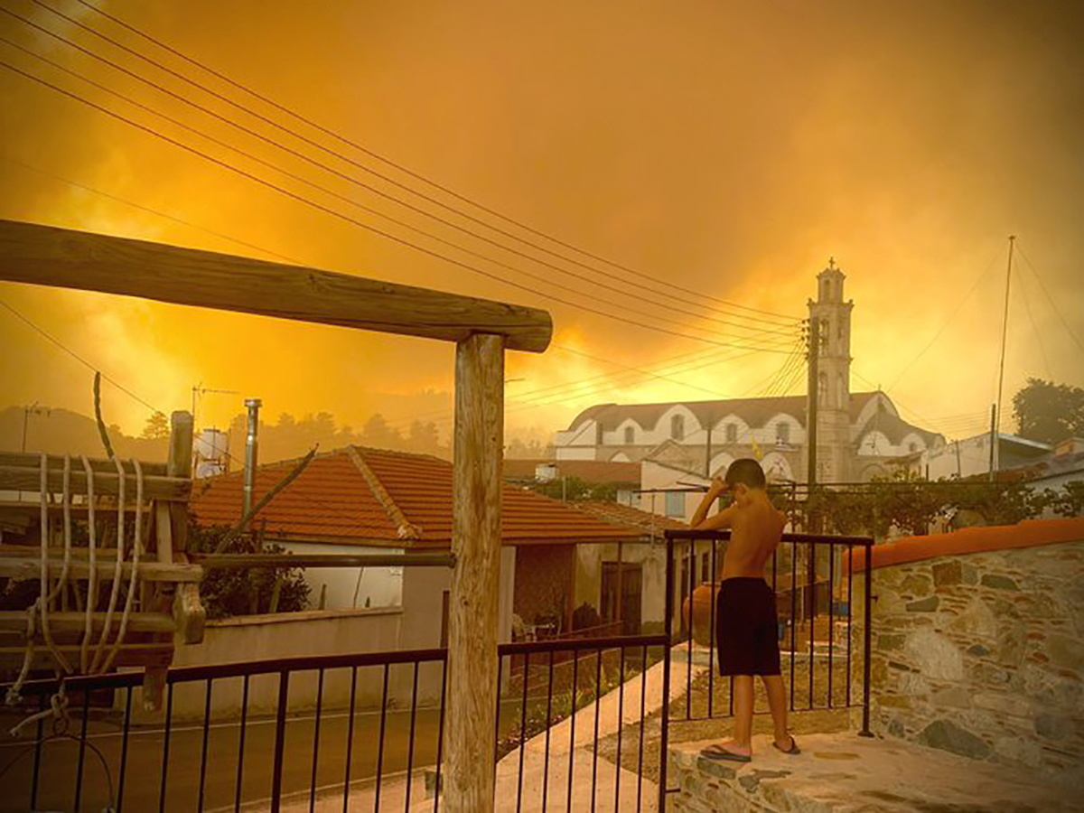 Smoke from a forest fire is seen in Ora village, Larnaca, Cyprus, July 3, 2021, in this picture obtained from social media. Mandatory credit ANDREA ANASTASIOU/via REUTERS