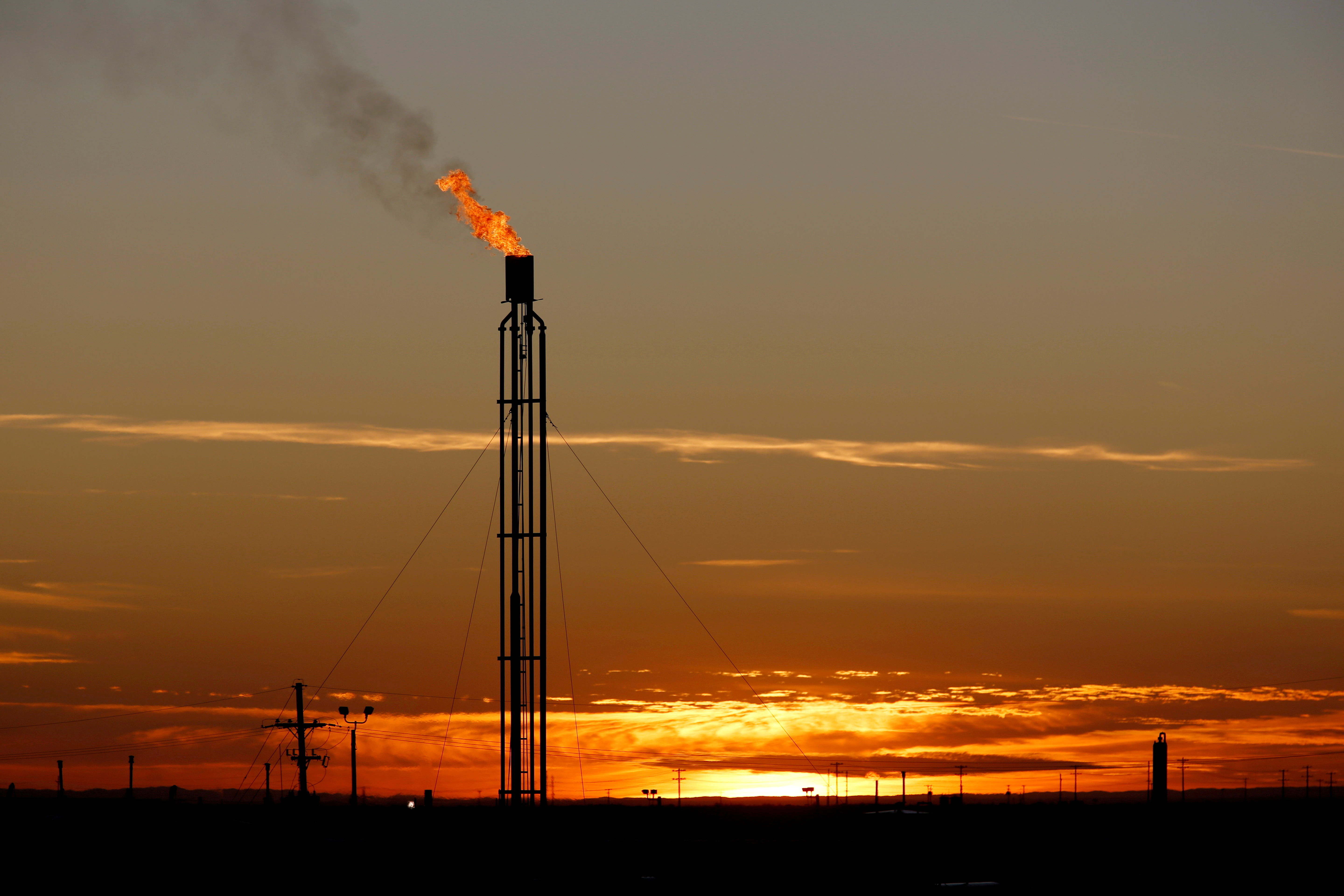 A flare burns excess natural gas in the Permian Basin in Loving County, Texas, U.S. November 23, 2019.  REUTERS/Angus Mordant
