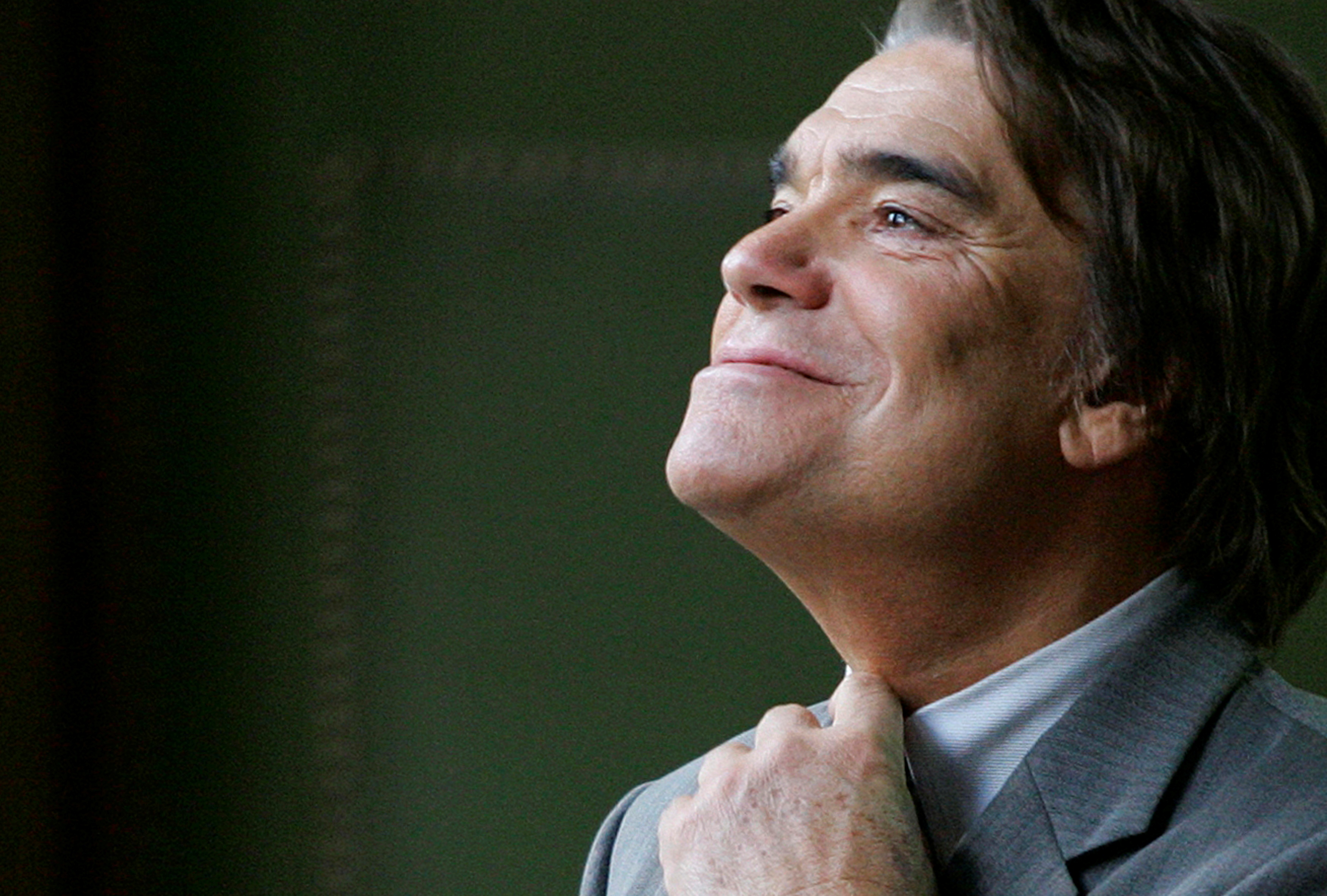 French businessman Bernard Tapie adjusts his tie at the Justice court in Paris in this file photo October 19, 2005. REUTERS/Charles Platiau/File Photo