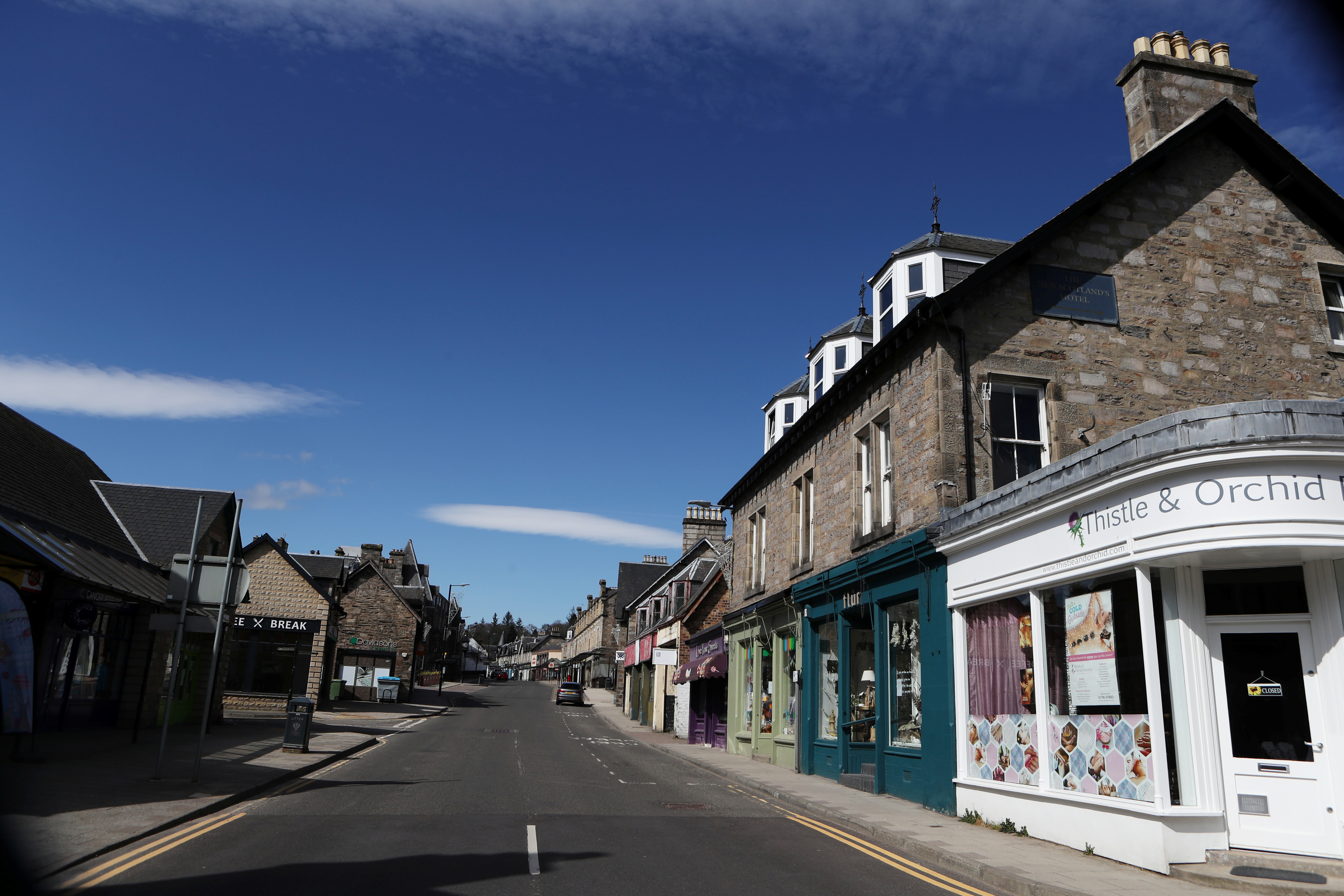 An empty street with closed shops is seen  as the spread of the coronavirus disease (COVID-19) continues Pitlochry, Scotland, Britain April 15, 2020. REUTERS/Russell Cheyne