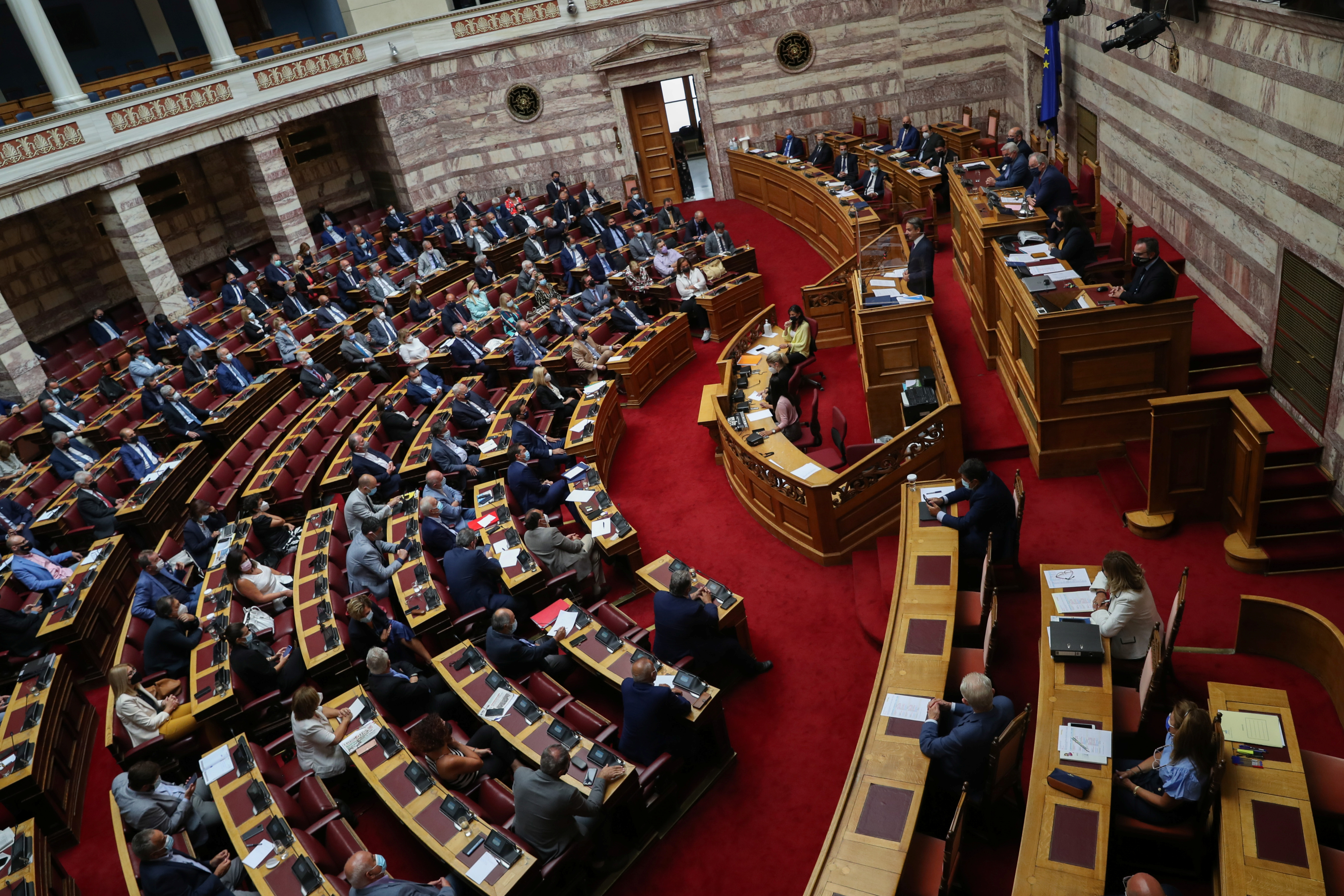 Greek Prime Minister Kyriakos Mitsotakis addresses lawmakers during a parliamentary session on recent wildfires, in Athens, Greece, August 25, 2021. REUTERS/Louiza Vradi