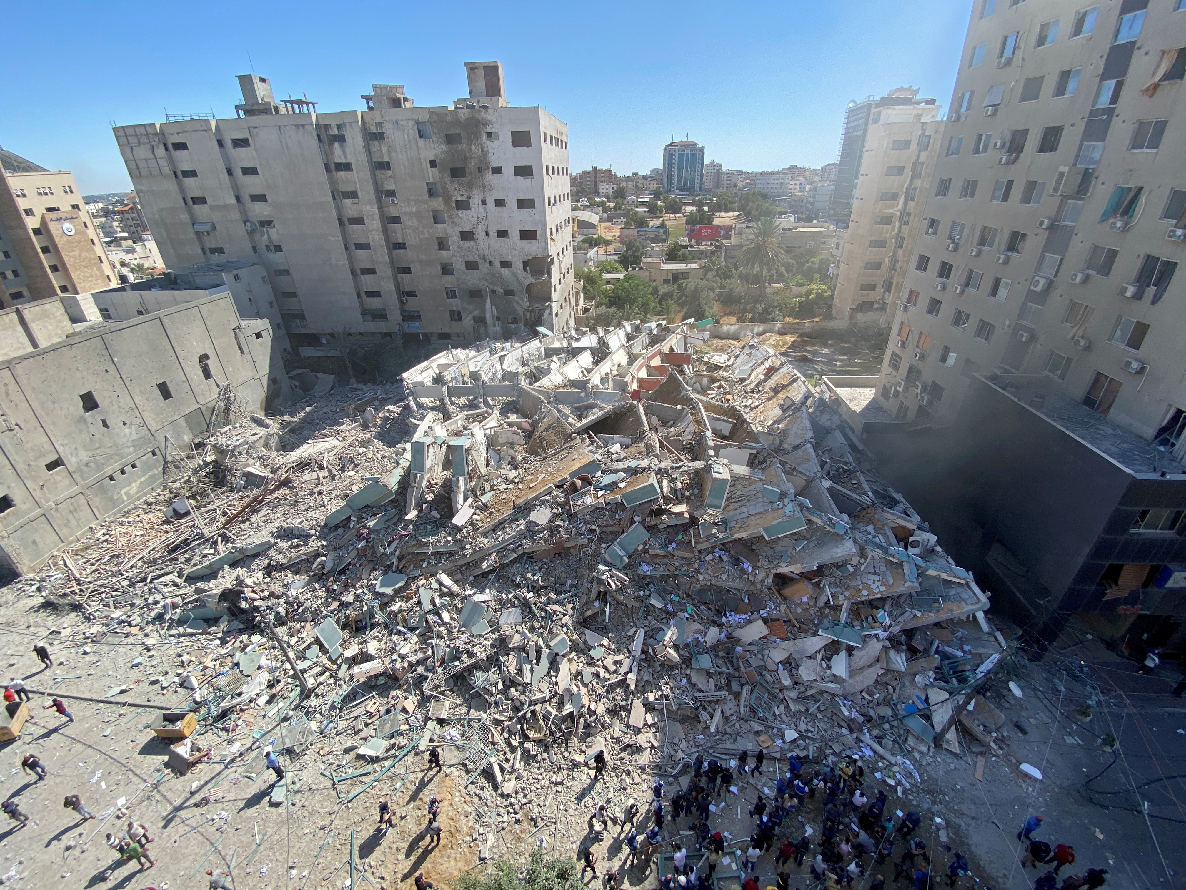 A tower housing AP, Al Jazeera offices collapses after Israeli missile strikes in Gaza city, May 15. REUTERS/Mohammed Salem/File Photo