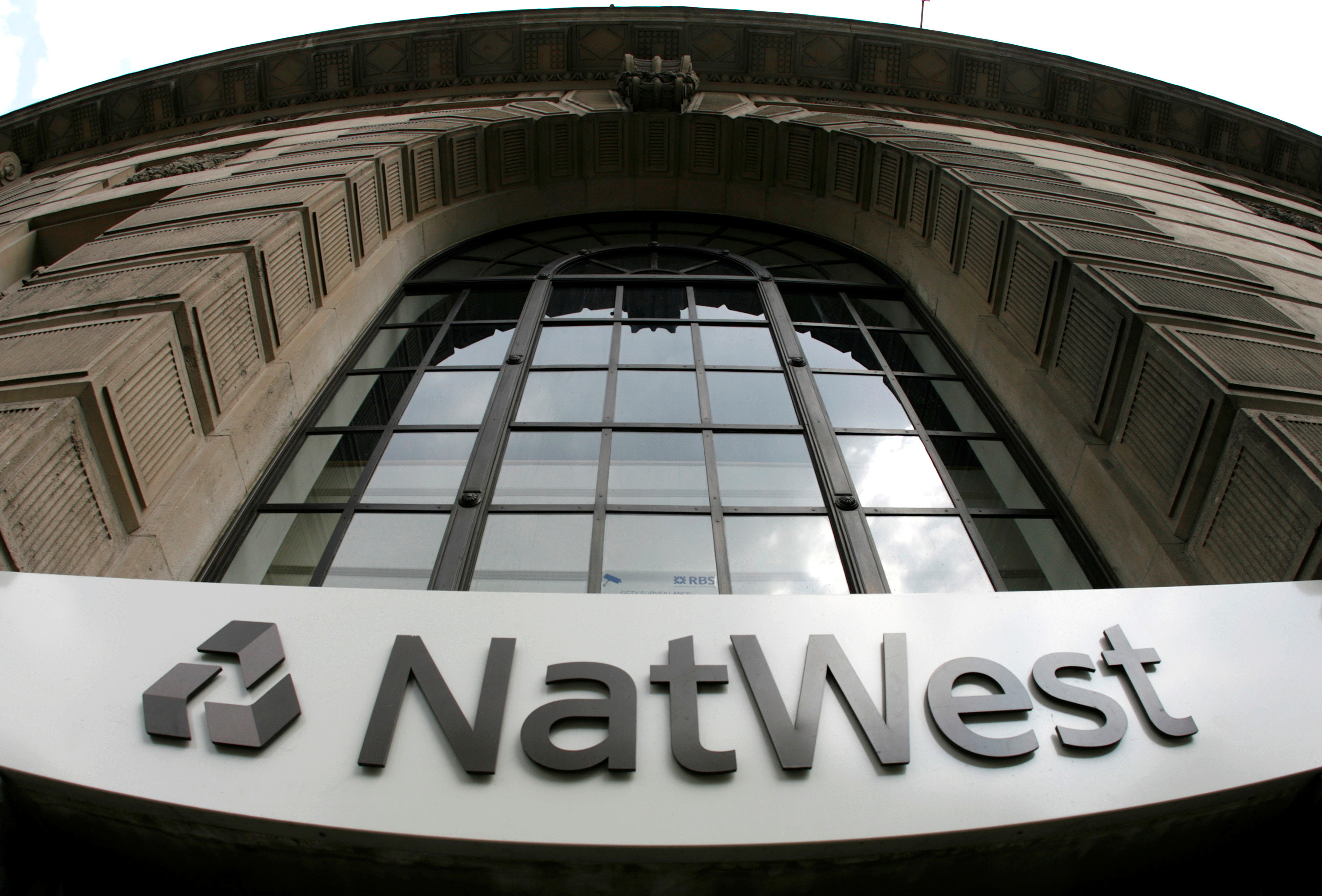 Signage at a branch of NatWest Bank pictured in central London,  May 21, 2008.  REUTERS/Luke MacGregor