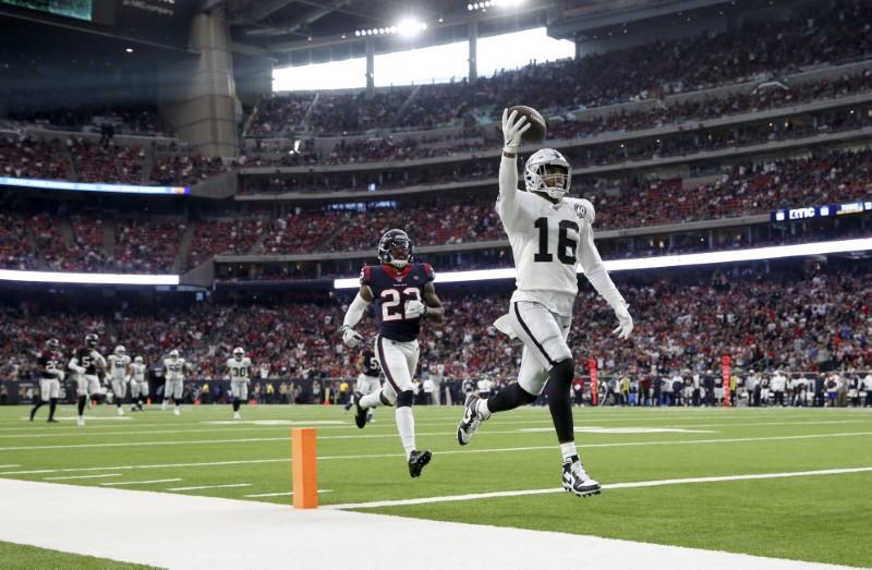Oct 27, 2019; Houston, TX, USA; Oakland Raiders wide receiver Tyrell Williams (16) scores a touchdown  past  Houston Texans cornerback Gareon Conley (22) during the third quarter at NRG Stadium. Mandatory Credit: Kevin Jairaj-USA TODAY Sports