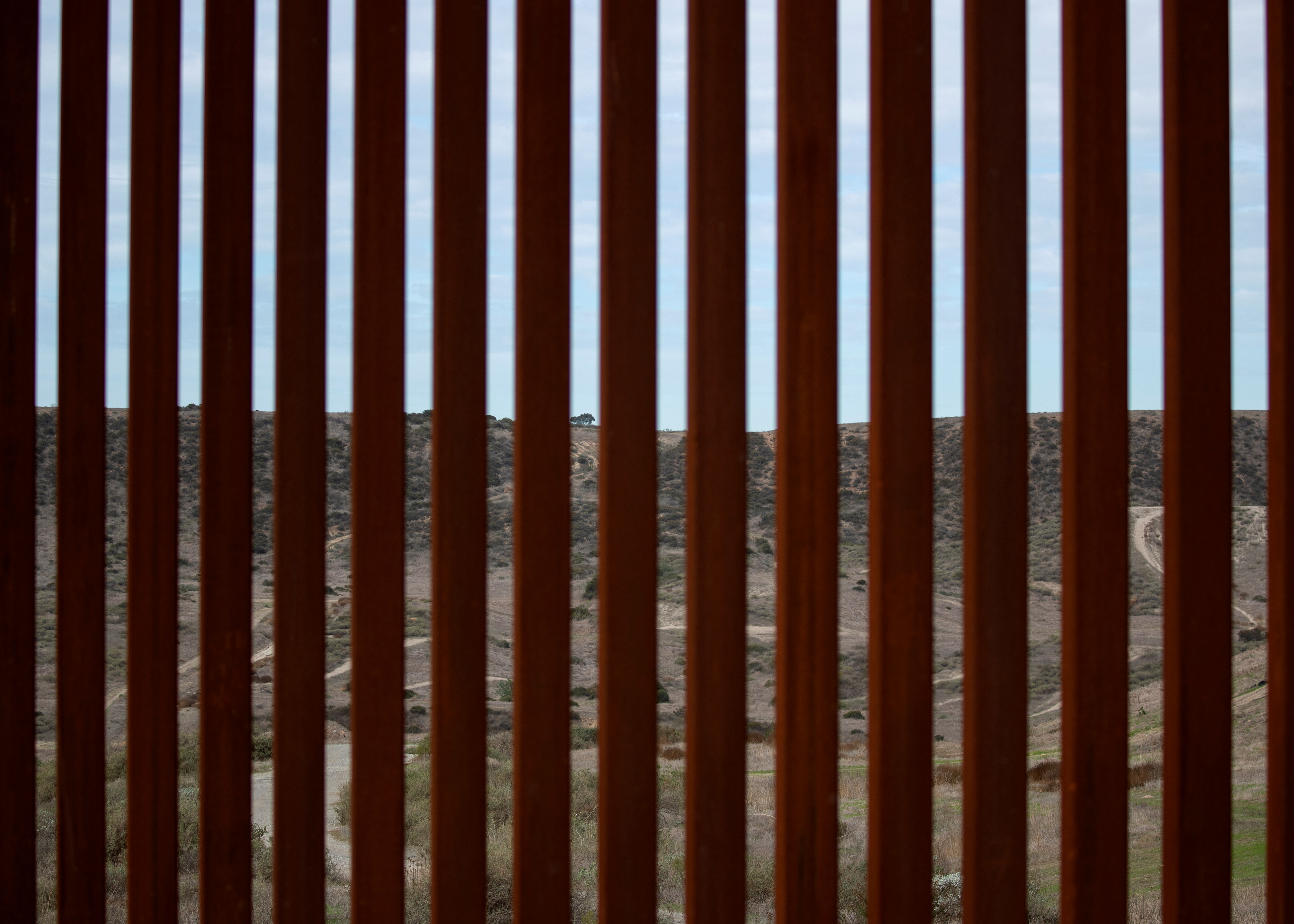 The United States is shown through a section of the new border wall between Mexico and the U.S. near San Diego, California, U.S., February 2, 2021. REUTERS/Mike Blake