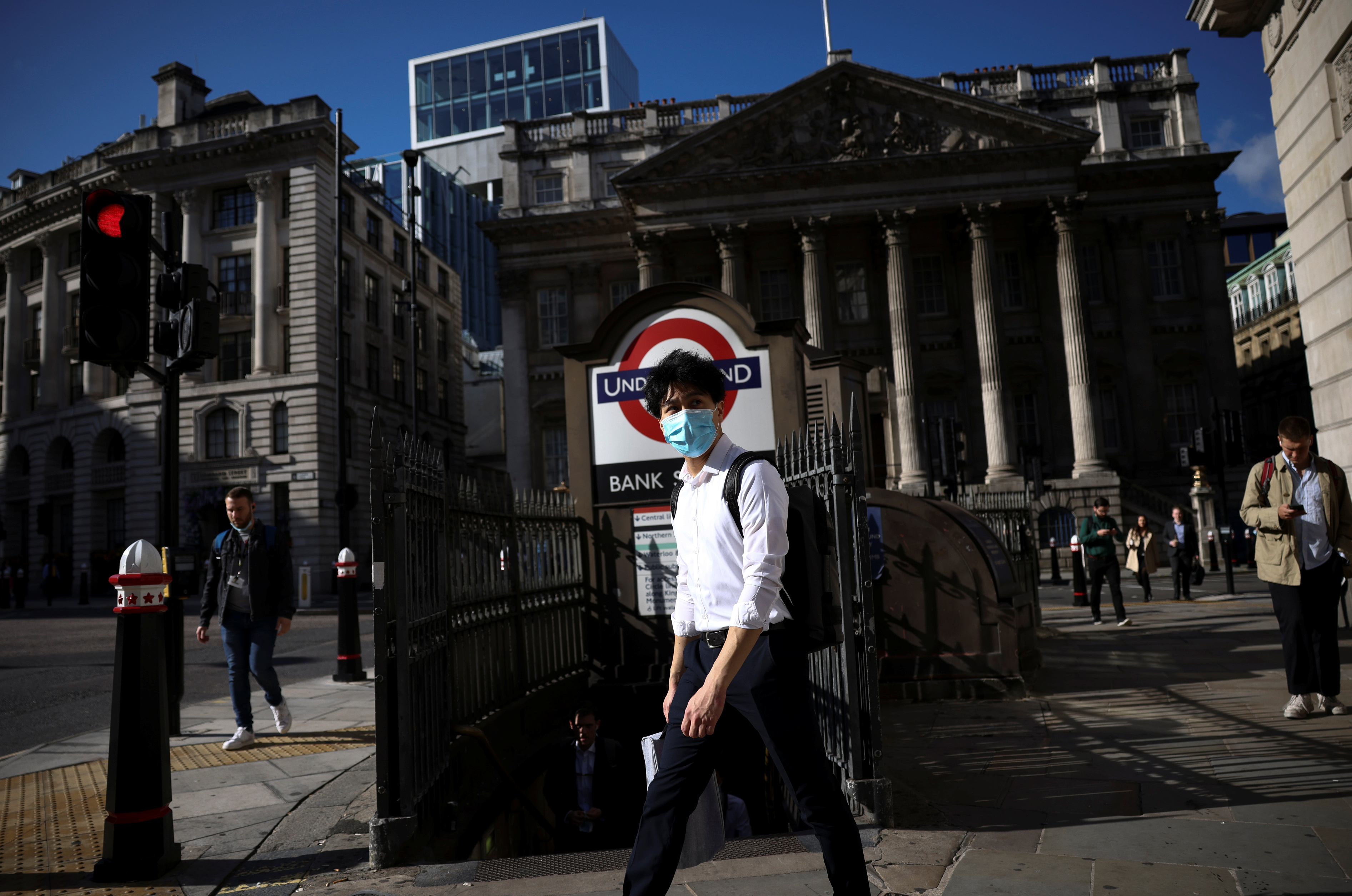 A person walks past Bank underground station during morning rush hour, amid the coronavirus disease (COVID-19) pandemic in London, Britain, July 29, 2021. REUTERS/Henry Nicholls