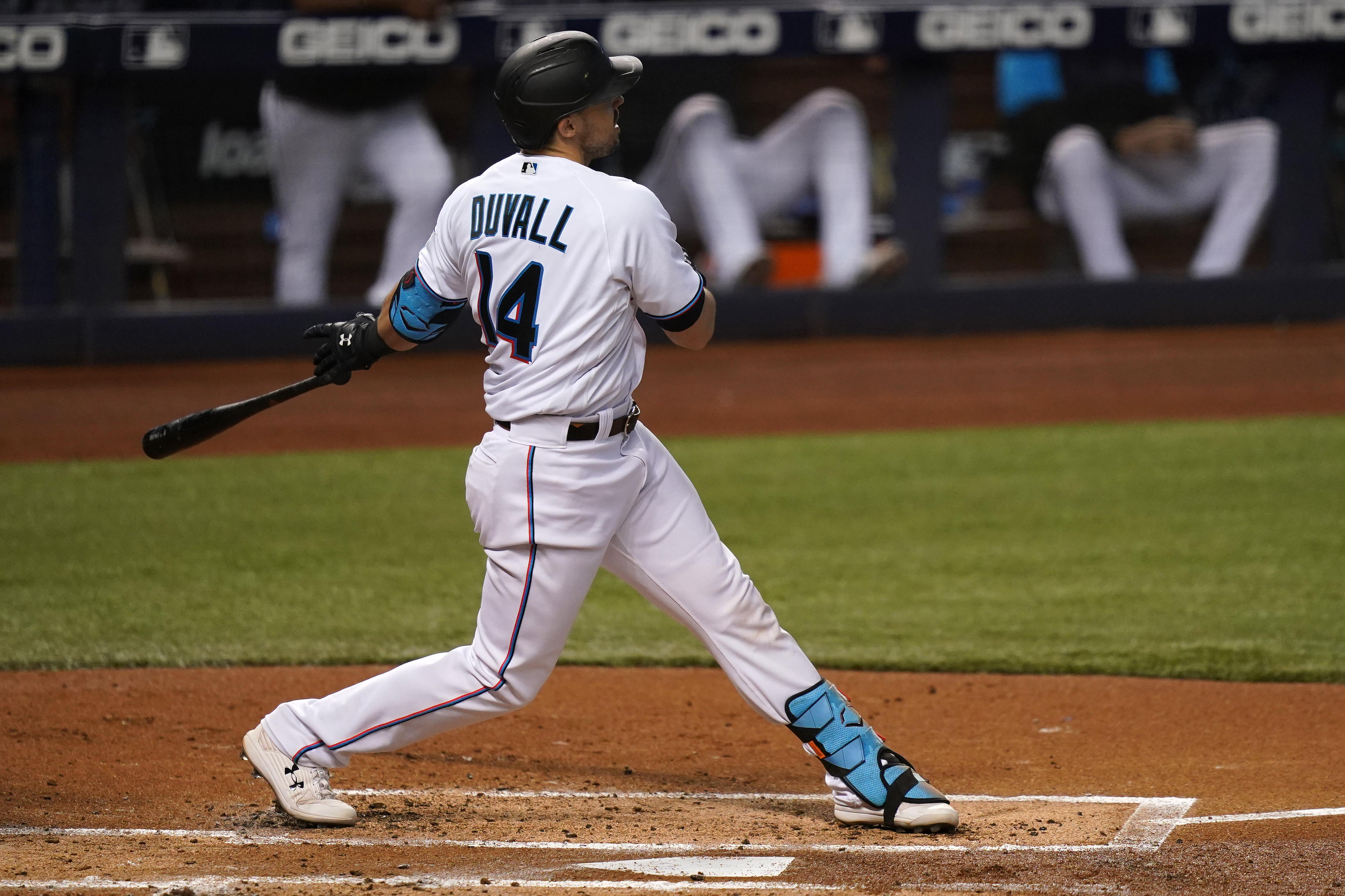 Jun 10, 2021; Miami, Florida, USA; Miami Marlins right fielder Adam Duvall (14) connects for a two-run homerun in the 2nd inning against the Colorado Rockies at loanDepot park. Mandatory Credit: Jasen Vinlove-USA TODAY Sports