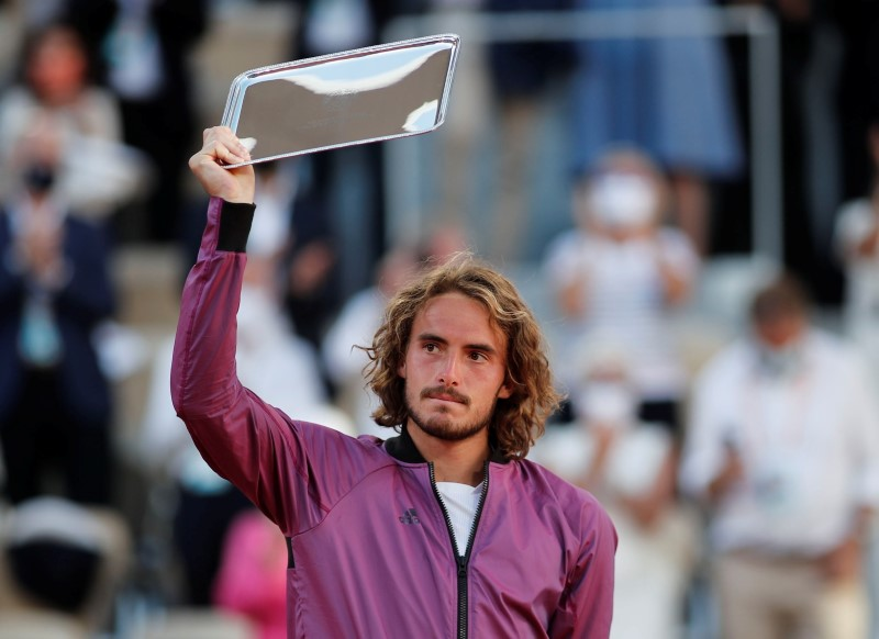 Tennis - French Open - Roland Garros, Paris, France - June 13, 2021 Greece's Stefanos Tsitsipas poses with the runners up trophy after losing the final against Serbia's Novak Djokovic REUTERS/Benoit Tessier