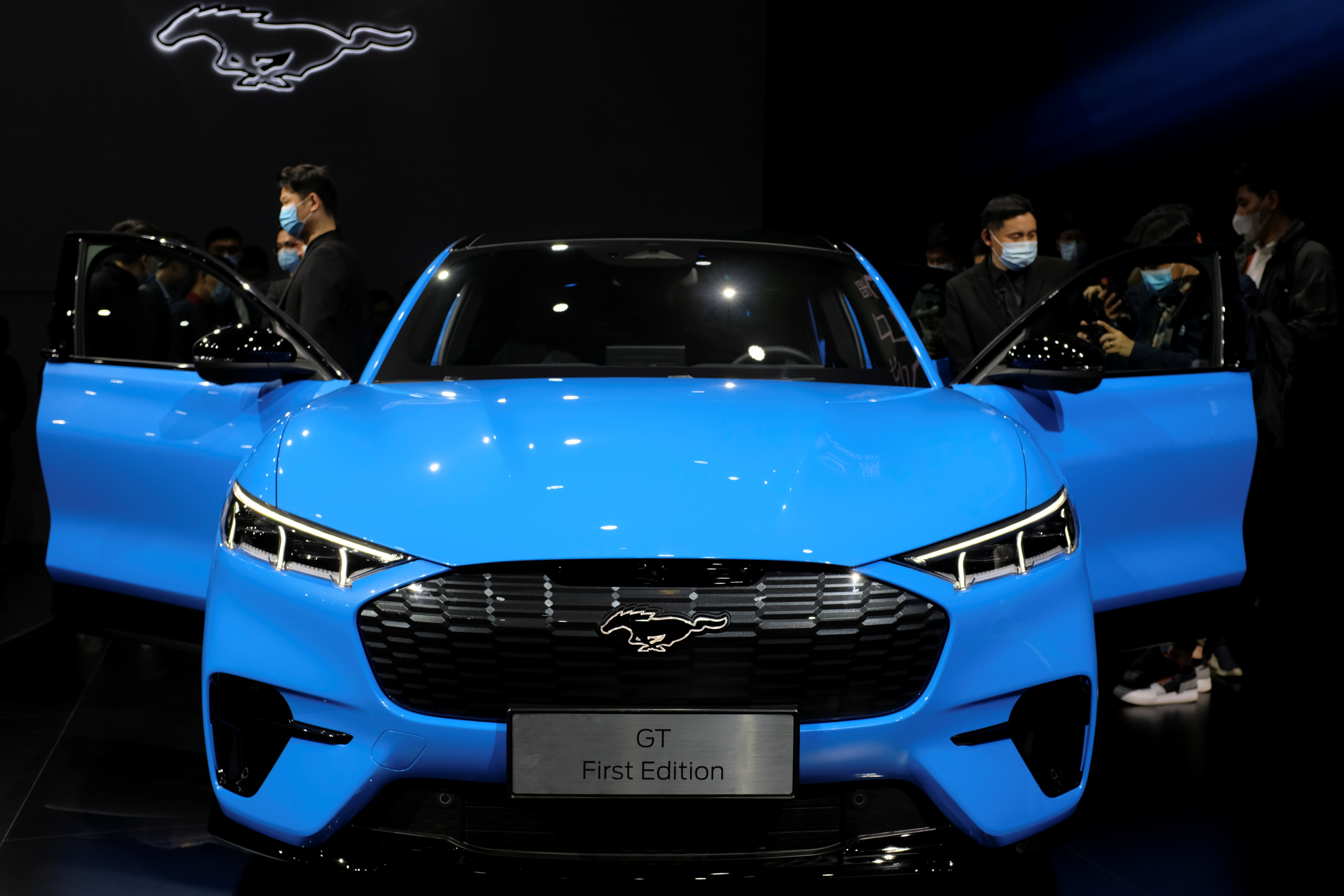 Visitors check on a Ford Mustang Mach-E electric vehicle displayed at a launch event in Shanghai, China April 13, 2021. REUTERS/Yilei Sun