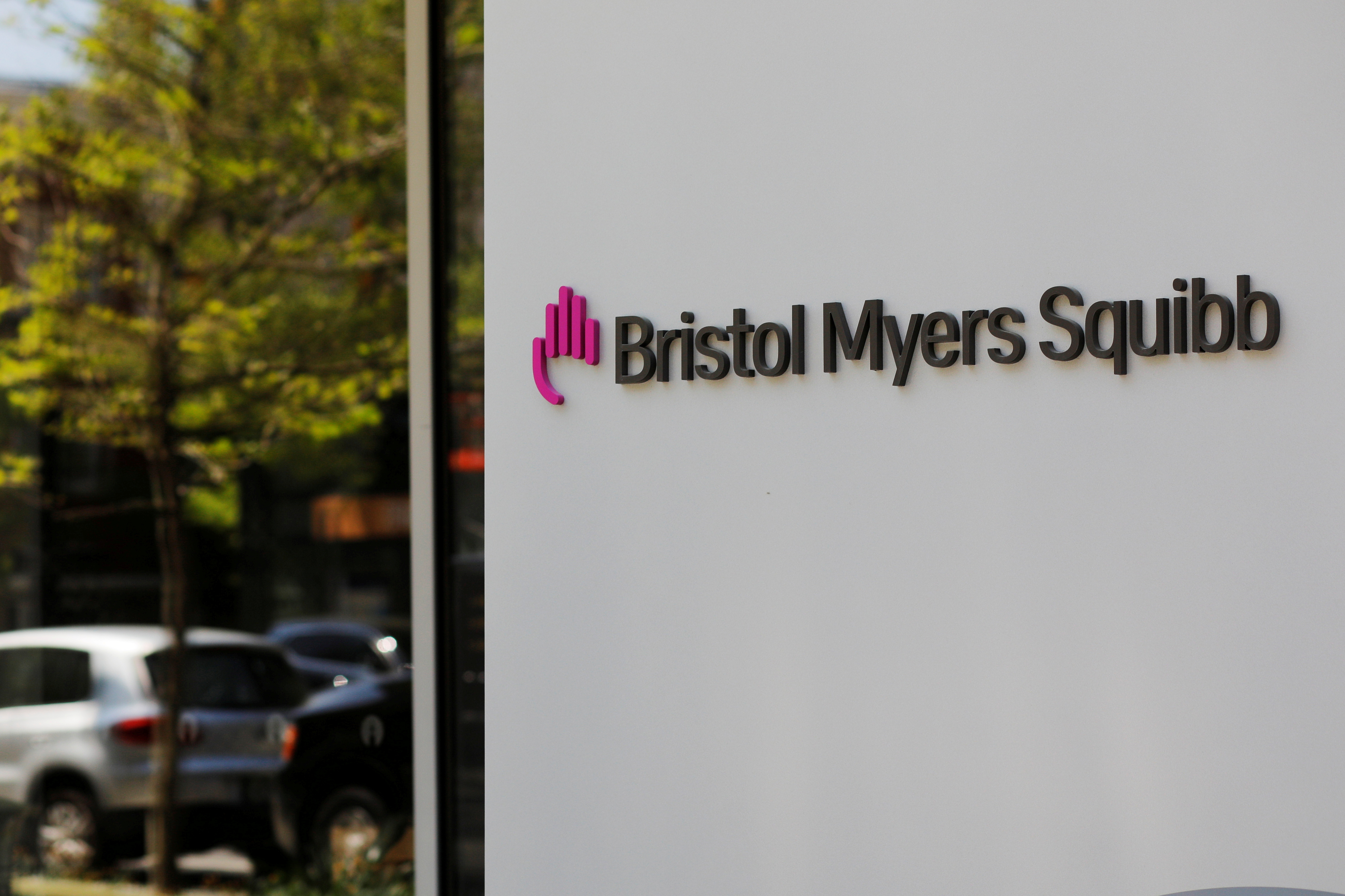 A sign stands outside a Bristol Myers Squibb facility in Cambridge, Massachusetts, U.S., May 20, 2021. REUTERS/Brian Snyder/File Photo