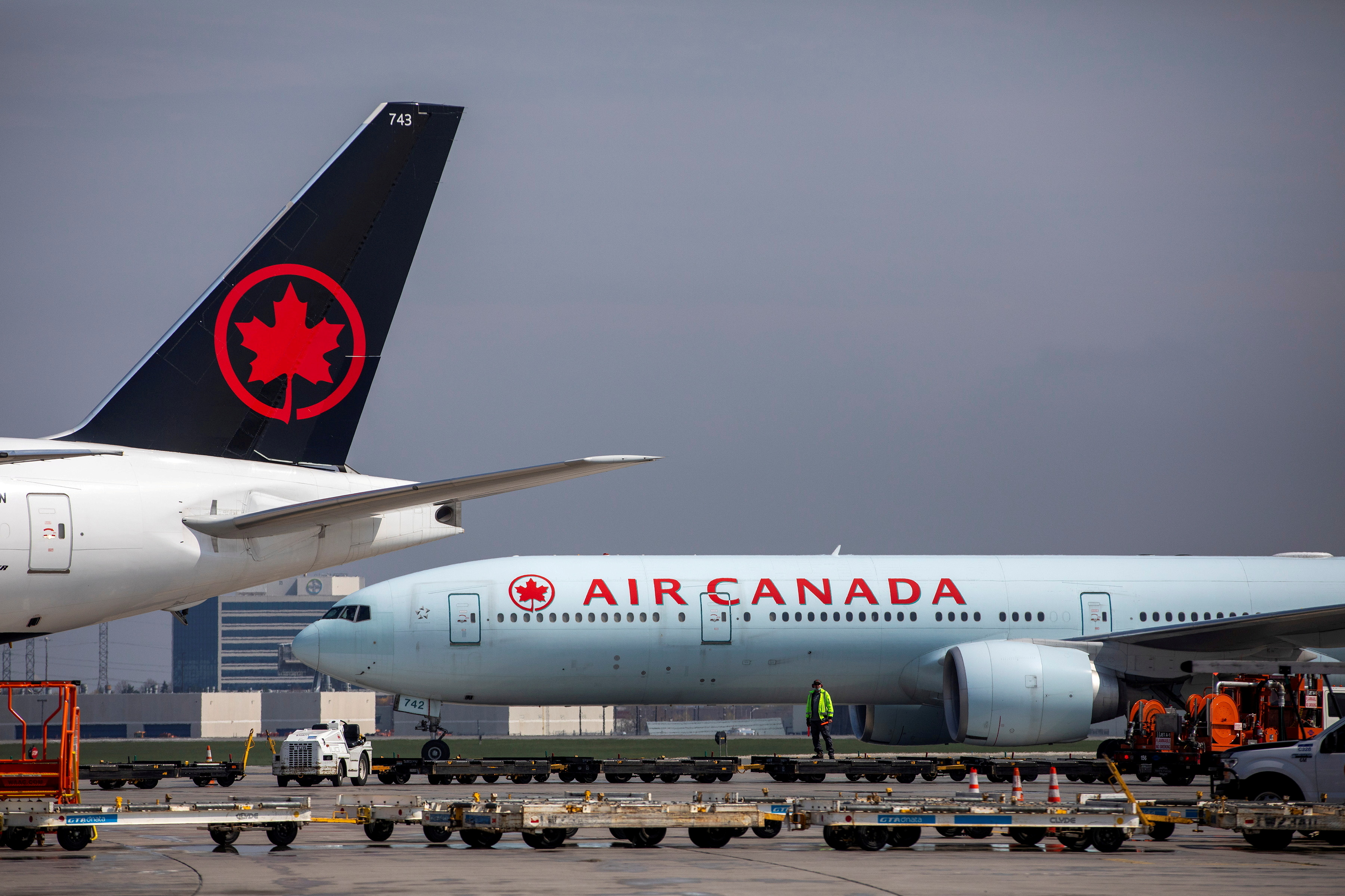 Air Canada planes are parked at Toronto Pearson Airport in Mississauga, Ontario, Canada April 28, 2021. REUTERS/Carlos Osorio/File Photo