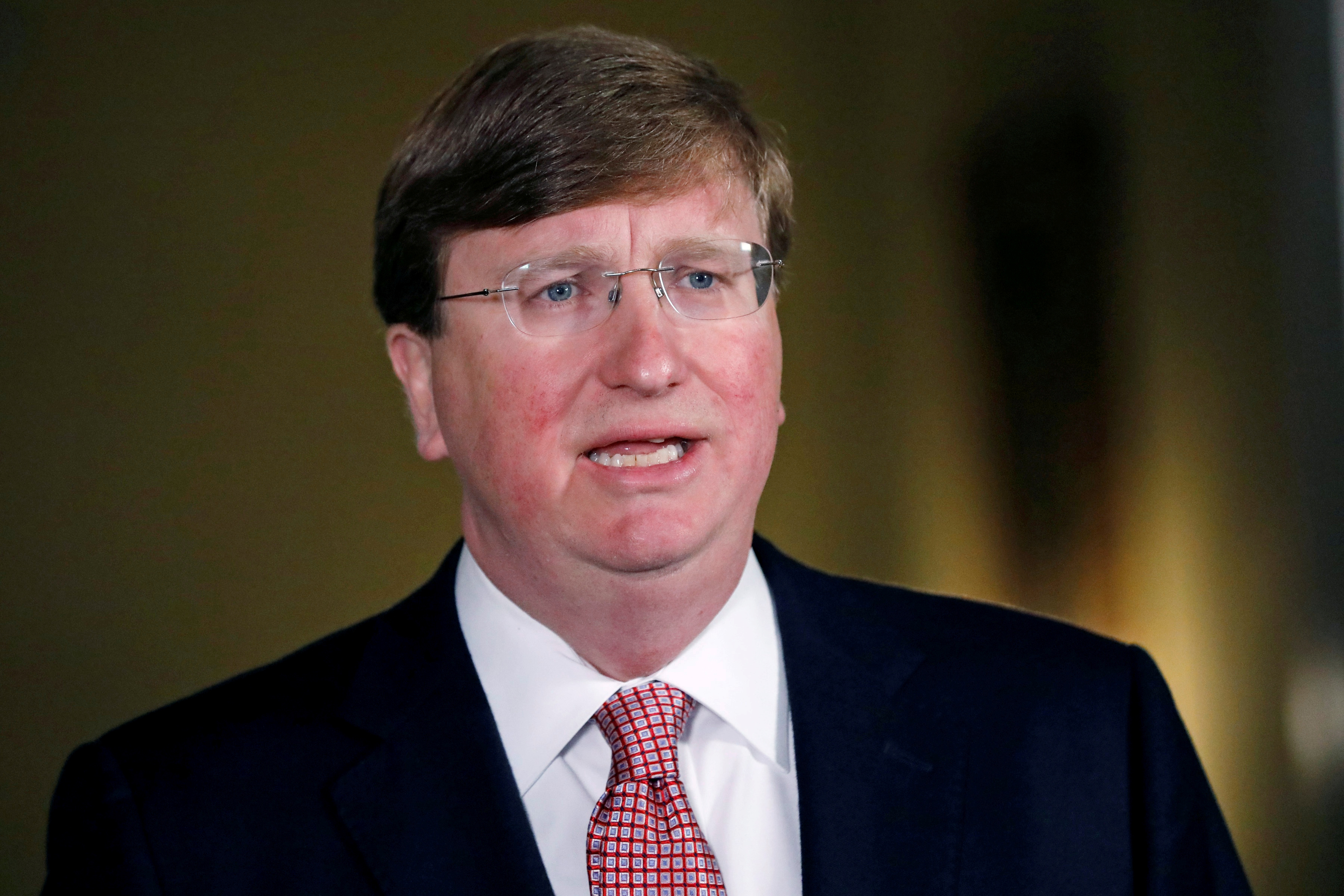 Mississippi Gov. Tate Reeves delivers a televised address prior to signing a bill retiring the last state flag in the United States with the Confederate battle emblem, during a ceremony at the Governor's Mansion in Jackson, Mississippi, U.S. June 30, 2020.  Rogelio V. Solis/Pool via REUTERS