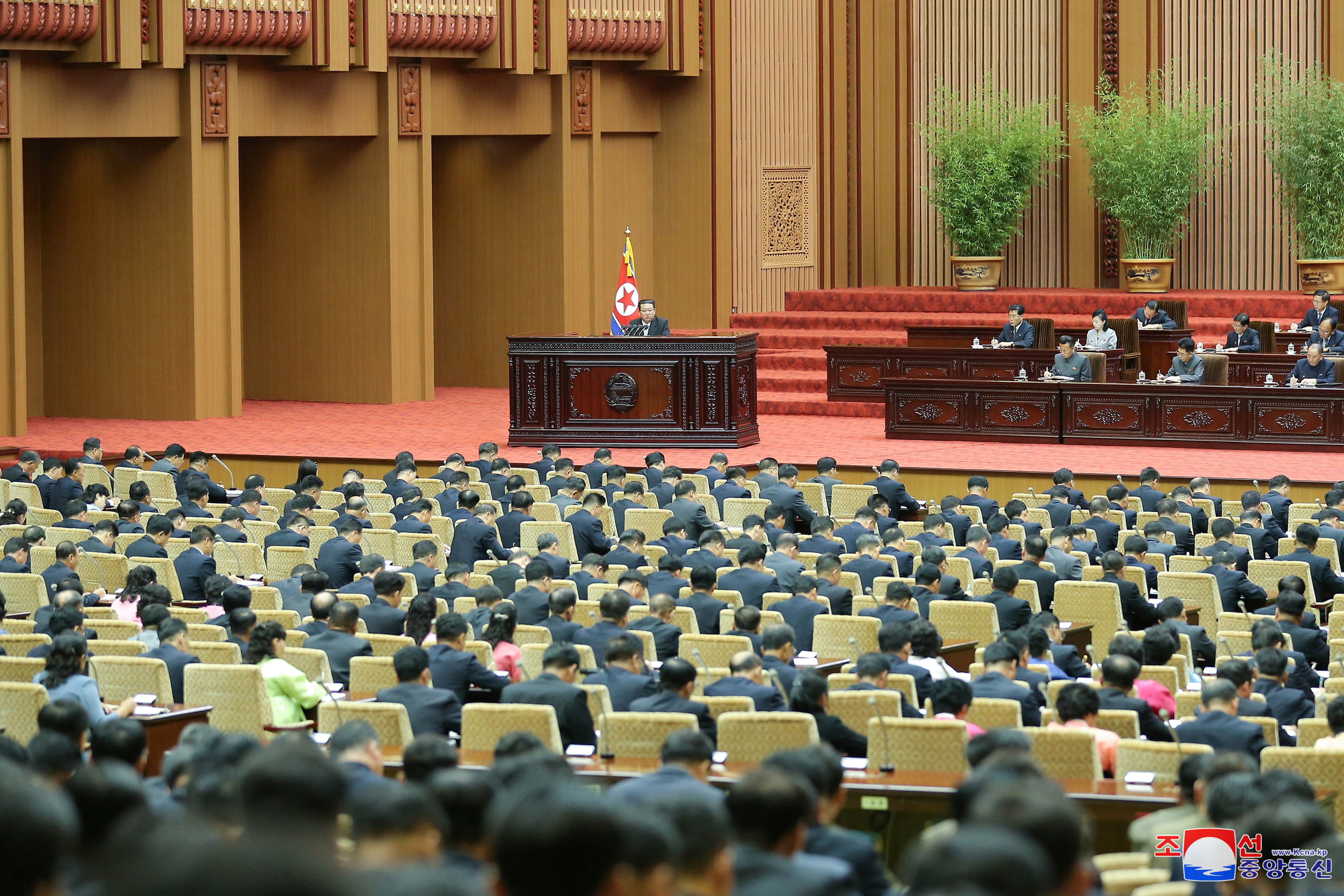 North Korean leader Kim Jong Un delivers a policy speech at the second-day sitting of the 5th Session of the 14th Supreme People's Assembly (SPA) of the Democratic People's Republic of Korea (DPRK) at the Mansudae Assembly Hall in Pyongyang, North Korea, in this undated photo released on September 30, 2021 by North Korea's Korean Central News Agency (KCNA). KCNA via REUTERS        ATTENTION EDITORS - THIS IMAGE WAS PROVIDED BY A THIRD PARTY. REUTERS IS UNABLE TO INDEPENDENTLY VERIFY THIS IMAGE. NO THIRD PARTY SALES. SOUTH KOREA OUT. NO COMMERCIAL OR EDITORIAL SALES IN SOUTH KOREA.