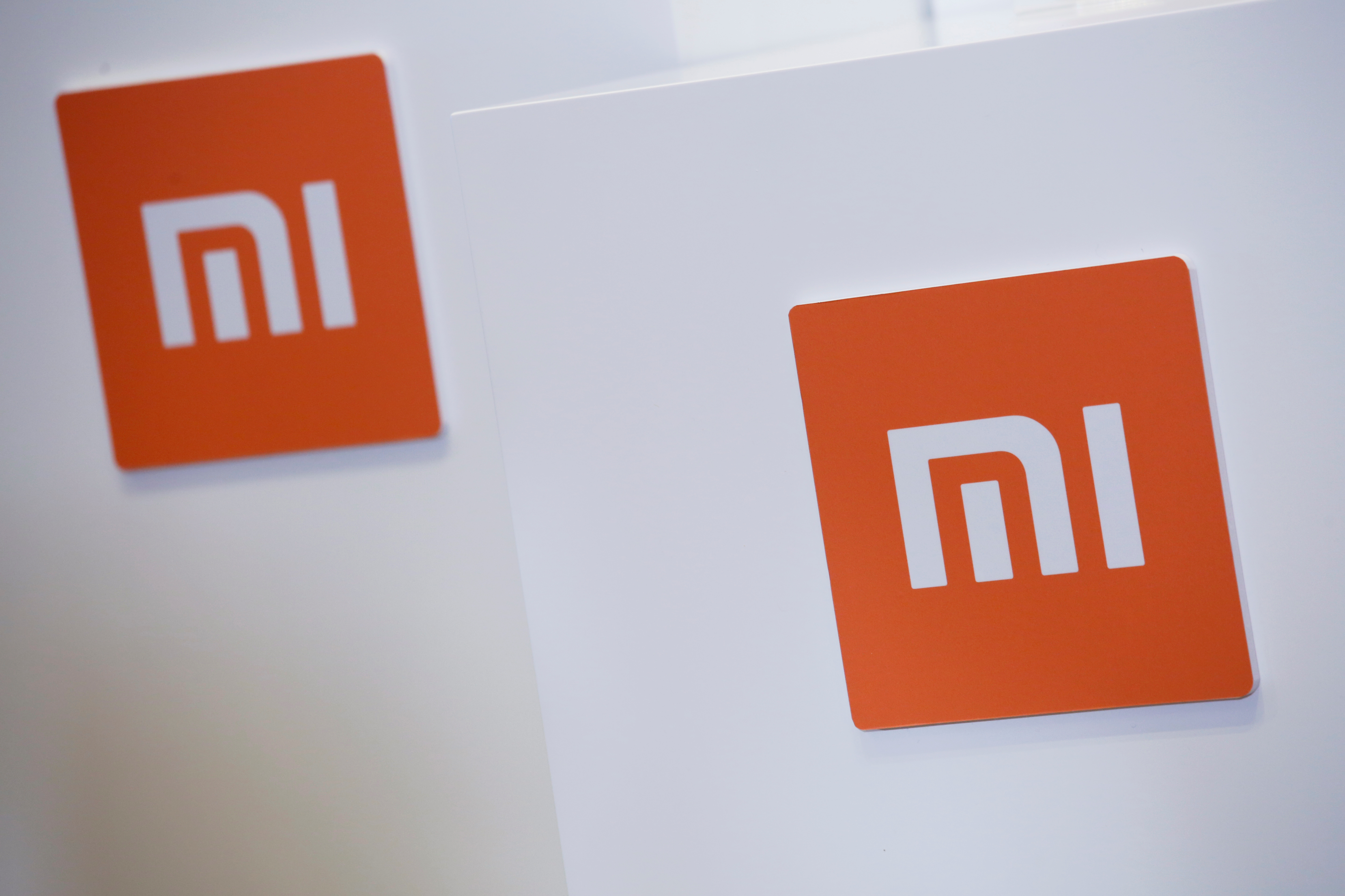 Xiaomi logos are seen during a news conference in Hong Kong, China June 23, 2018. REUTERS/Bobby Yip