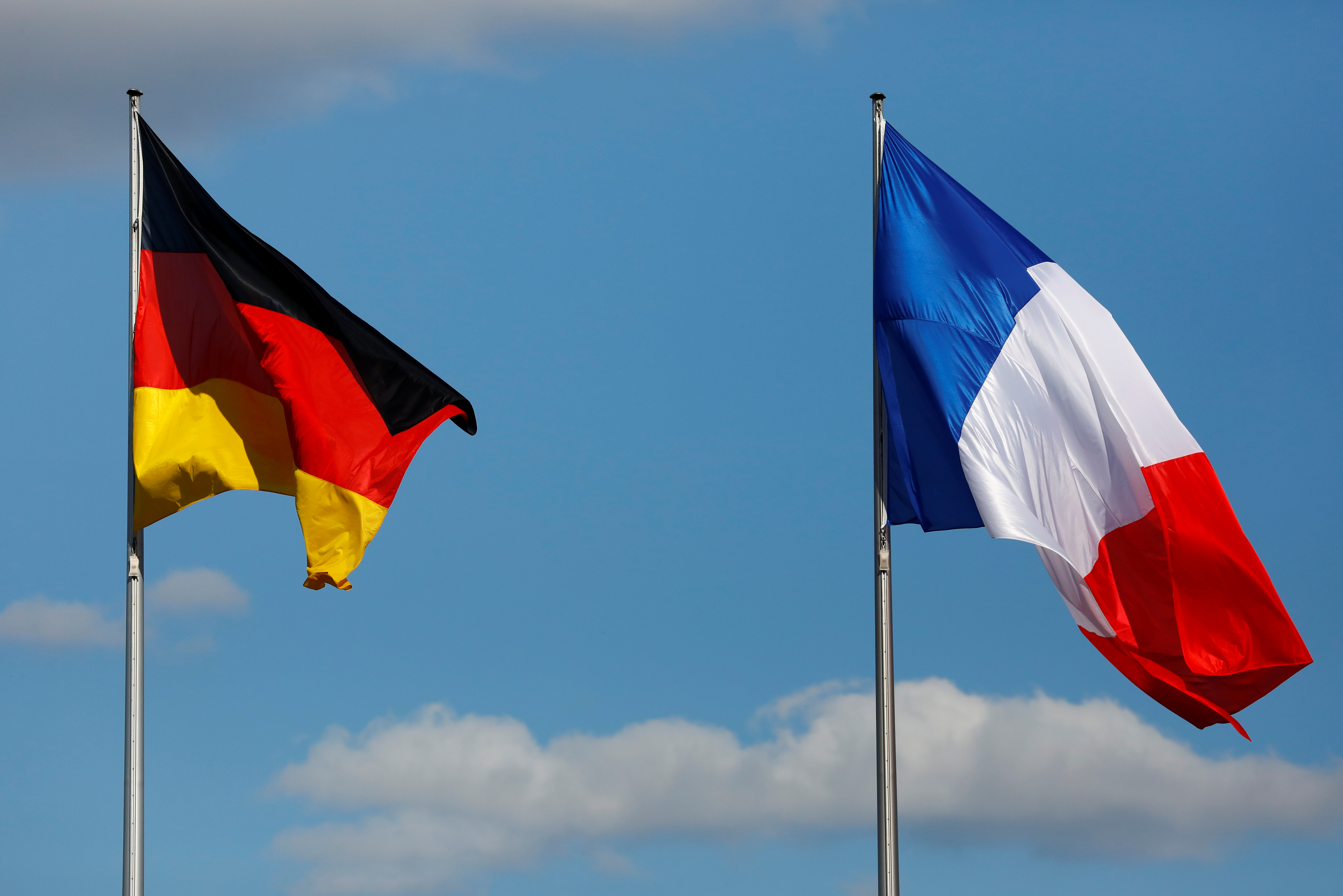 The flags of Germany and France are seen in front of the the Chancellery, before the meeting between German Chancellor Angela Merkel and French President Emmanuel Macron in Berlin, Germany May 15, 2017. REUTERS/Pawel Kopczynski