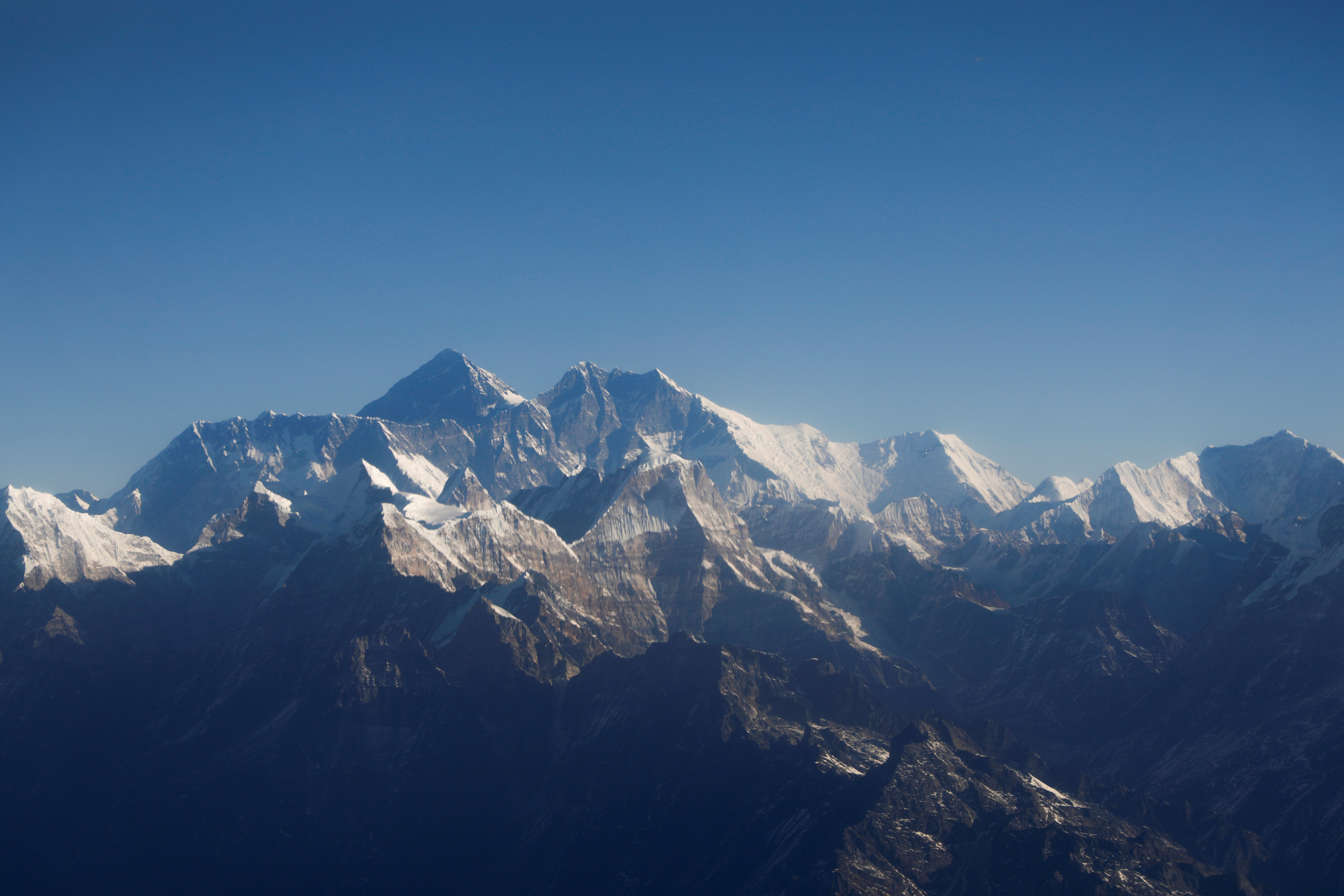Mount Everest, the world highest peak, and other peaks of the Himalayan range are seen through an aircraft window during a mountain flight from Kathmandu, Nepal January 15, 2020. REUTERS/Monika Deupala/File Photo