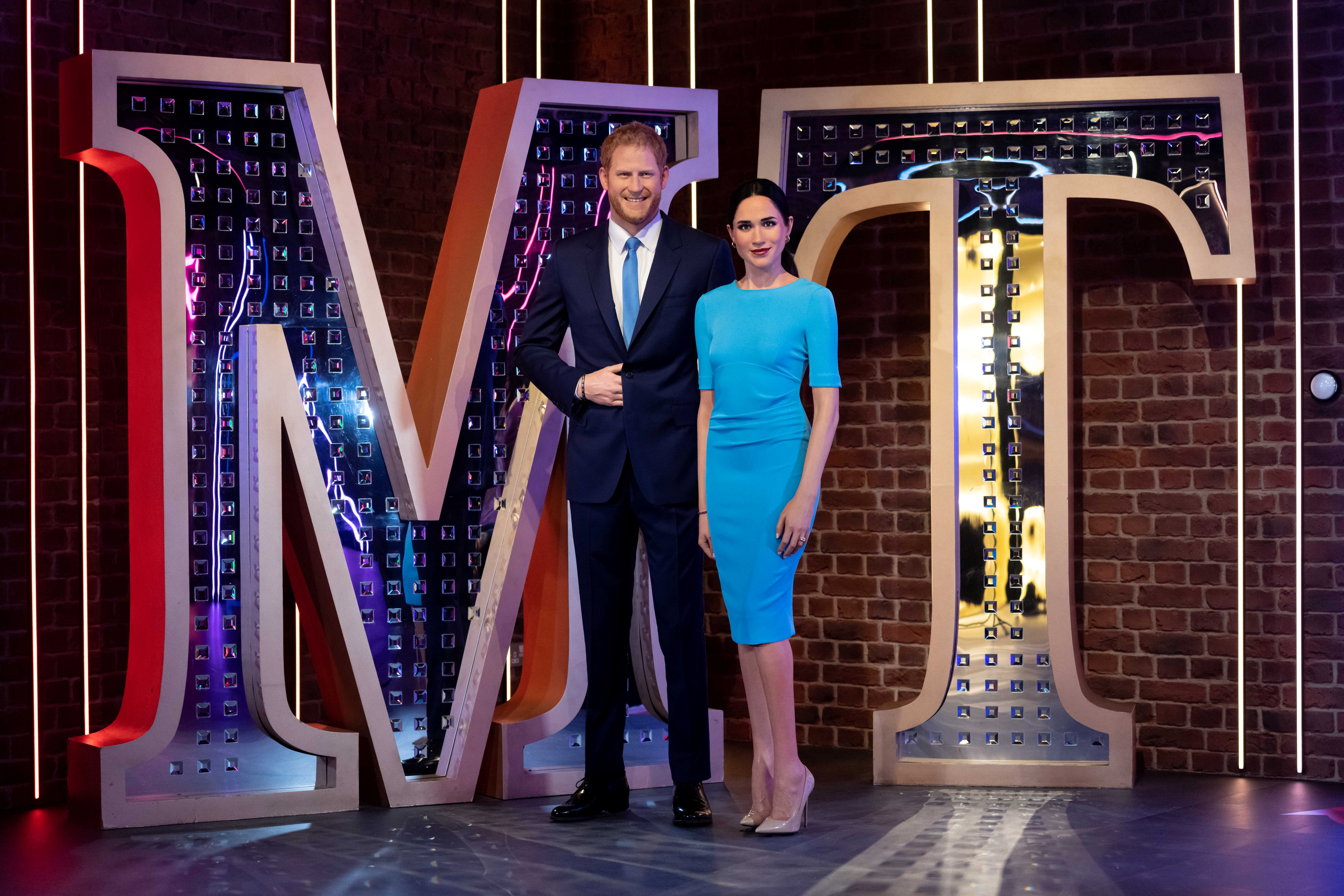 Figures of Madame Tussauds London's Britain's Prince Harry and Meghan, Duchess of Sussex, stand in their new position in London, Britain May 12, 2021.  Madame Tussauds London/Handout via REUTERS