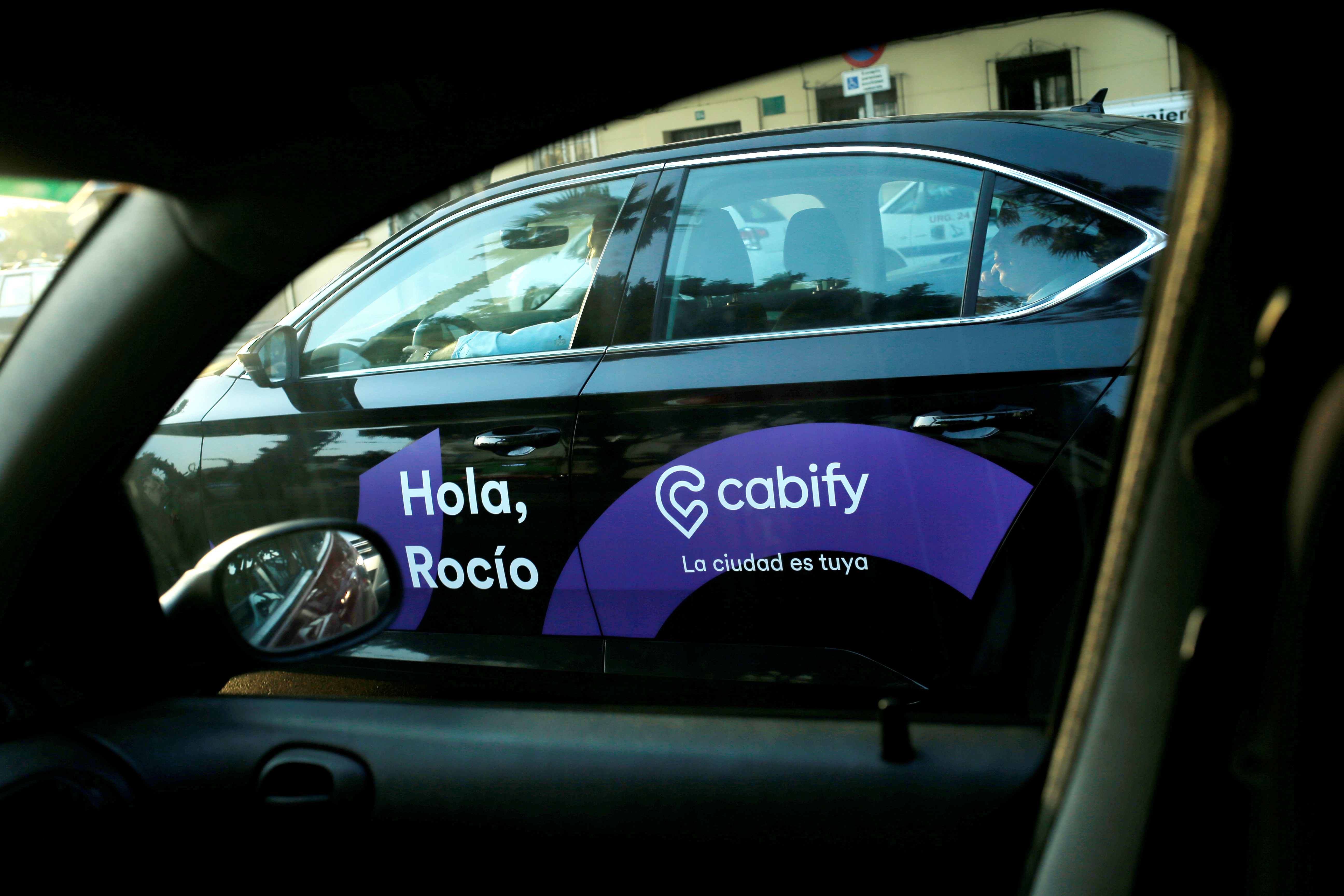 A Cabify taxi car is seen through the window of a car in Malaga, southern Spain August 3, 2018. REUTERS/Jon Nazca