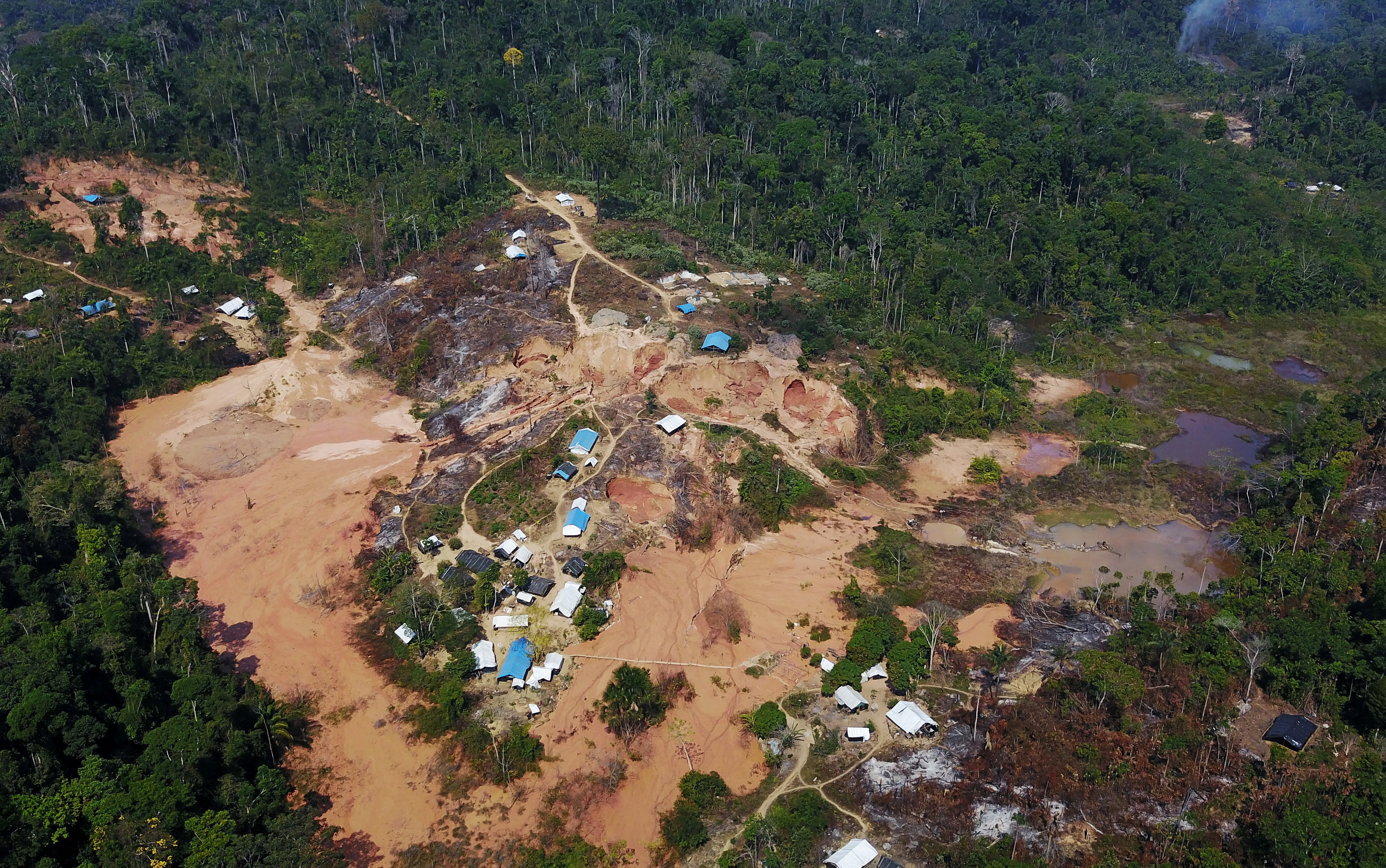 An aerial view show a wildcat gold mine, also known as a garimpo, at a deforested area of the Amazon rainforest near Crepurizao, in the municipality of Itaituba, Para State, Brazil, August 6, 2017. Picture taken with a drone.  REUTERS/Nacho Doce/File Photo