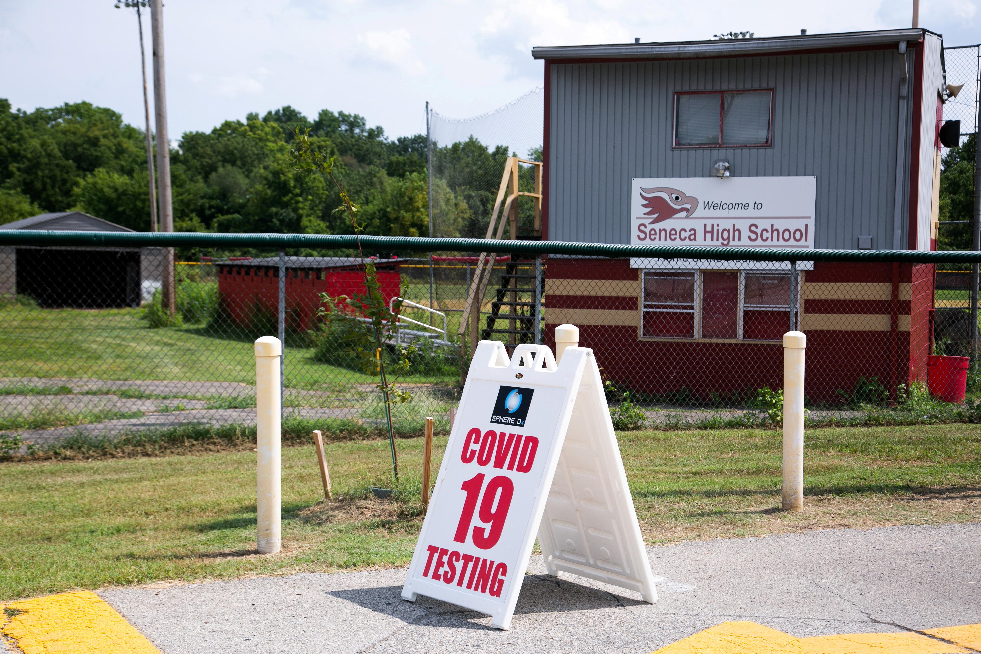 A coronavirus disease (COVID-19) testing sign is seen in front of Seneca High School, a day before returning to school in Louisville, Kentucky, U.S., August 10, 2021.  REUTERS/Amira Karaoud/File Photo