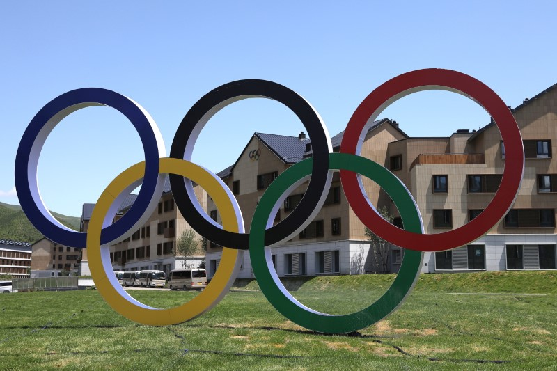 A giant monument of Olympic Rings is seen at the Zhangjiakou Olympic and Paralympic village for the Beijing 2022 Winter Olympic Games during an organised media tour in Zhangjiakou, Hebei province, China July 14, 2021. Picture taken July 14, 2021. REUTERS/Tingshu Wang