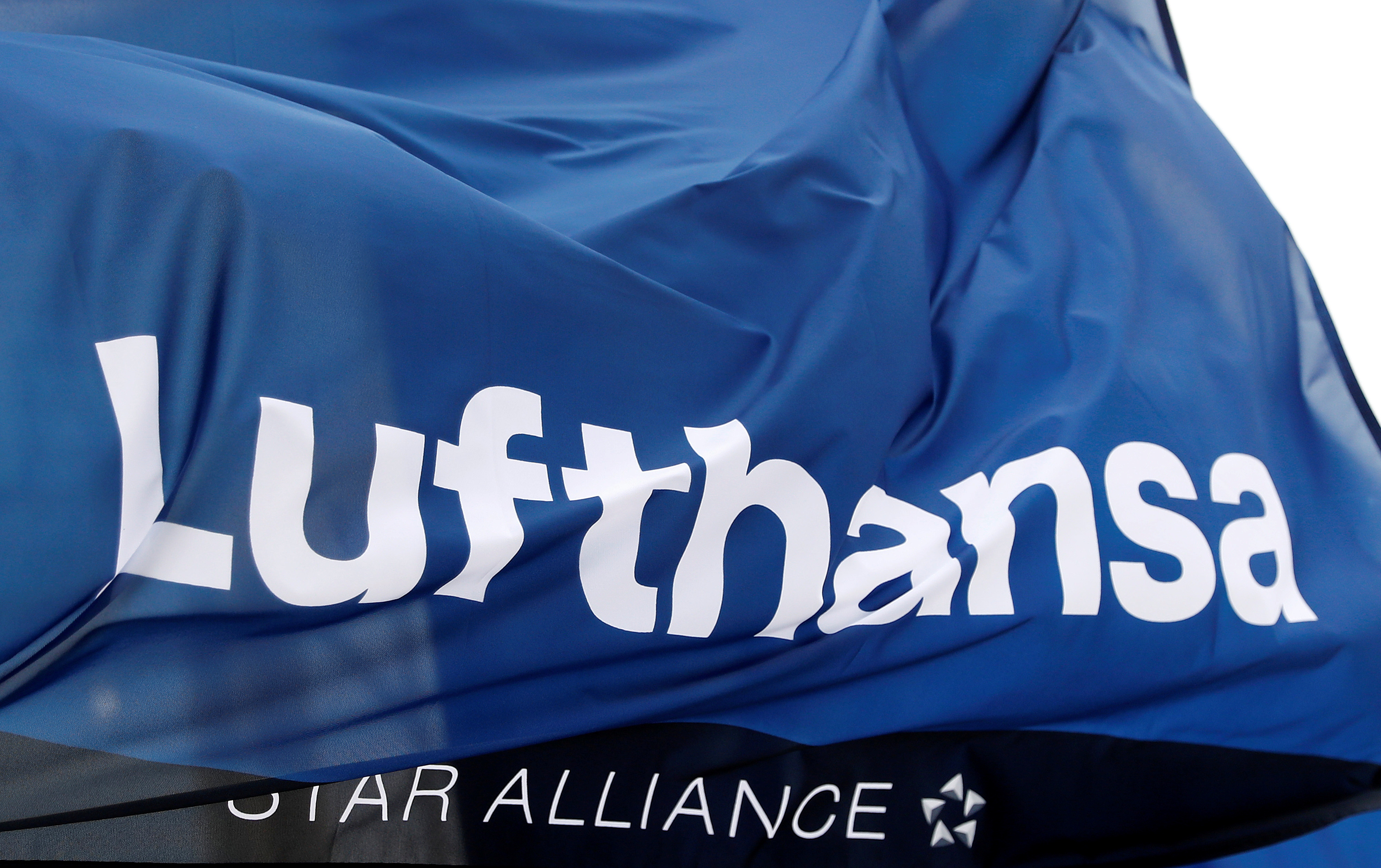 A flag of German air carrier Lufthansa flutters in the wind on the day of the airline's annual general meeting at the airport in Frankfurt, Germany, May 4, 2021.  REUTERS/Kai Pfaffenbach/File Photo