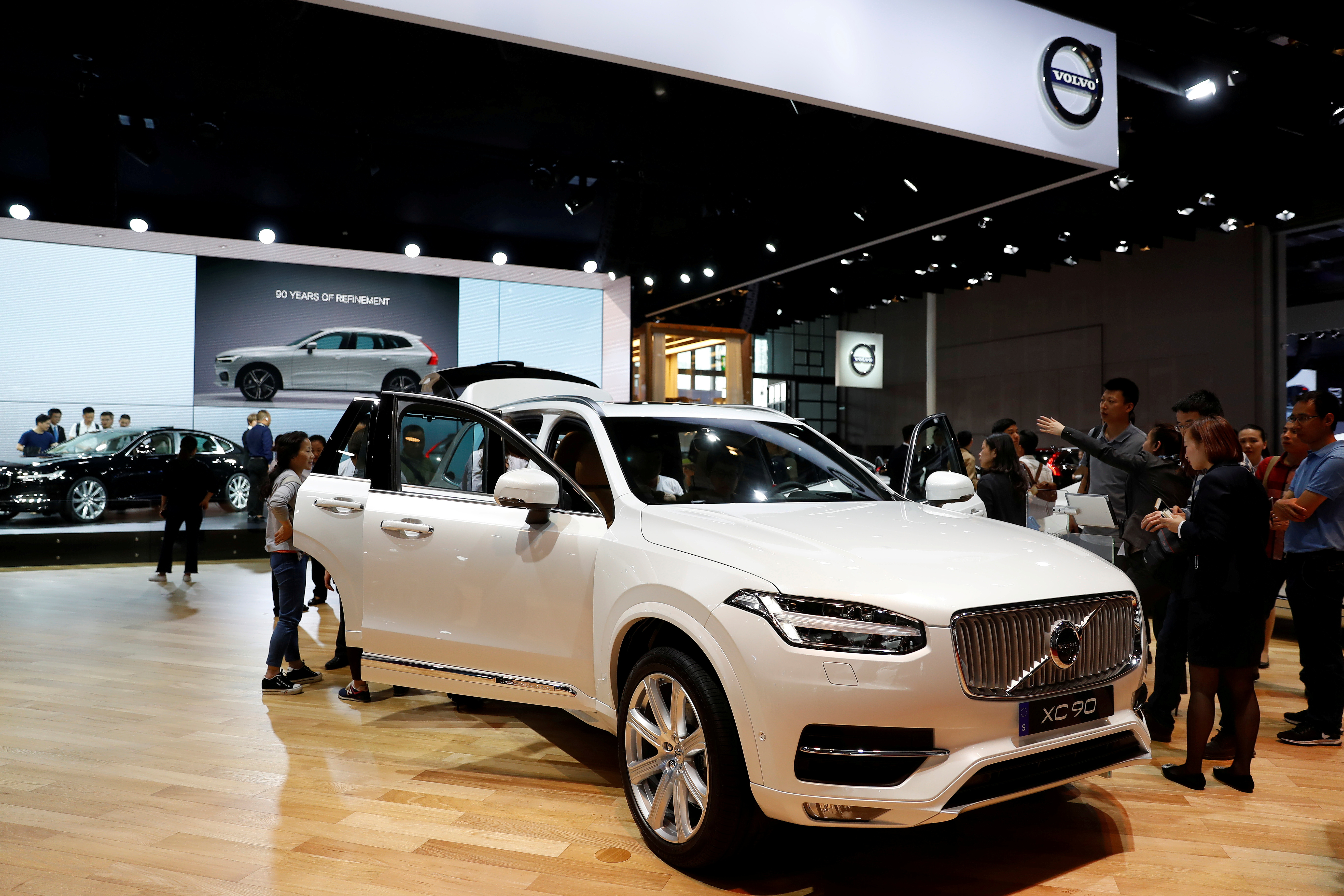 Visitors look at the Volvo XC90 at the Shanghai Auto Show, in Shanghai, China April 20, 2017. Volvo Cars said in June 2021 it intends to replace most of its gasoline-powered vehicles with new all-electric models by 2030. REUTERS/Aly Song/File Photo