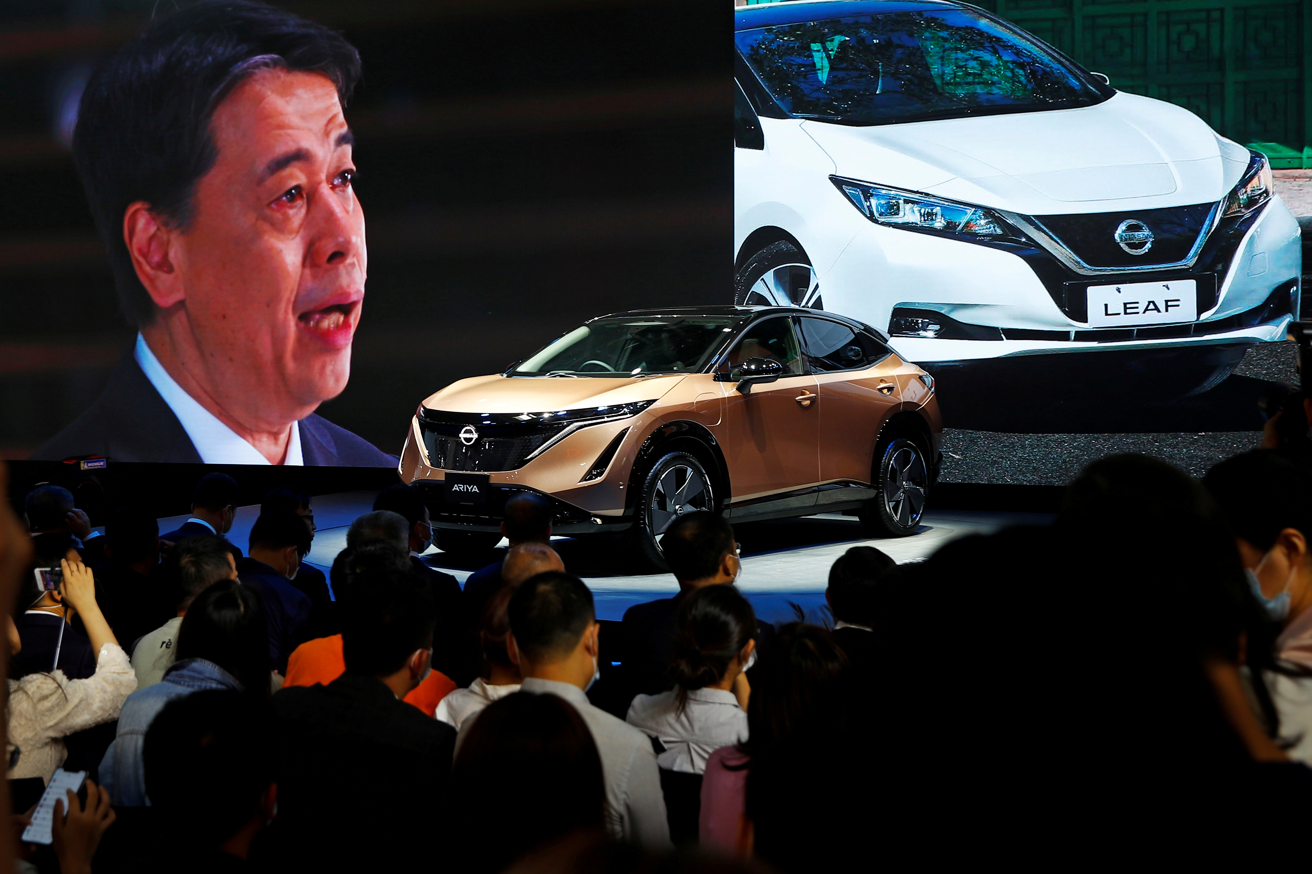 Nissan Chief Executive Officer Makoto Uchida speaks at Nissan booth via video link during the presentation of Nissan's Ariya model during the Beijing International Automotive Exhibition, or Auto China show, in Beijing, China September 26, 2020. REUTERS/Thomas Peter/File Photo