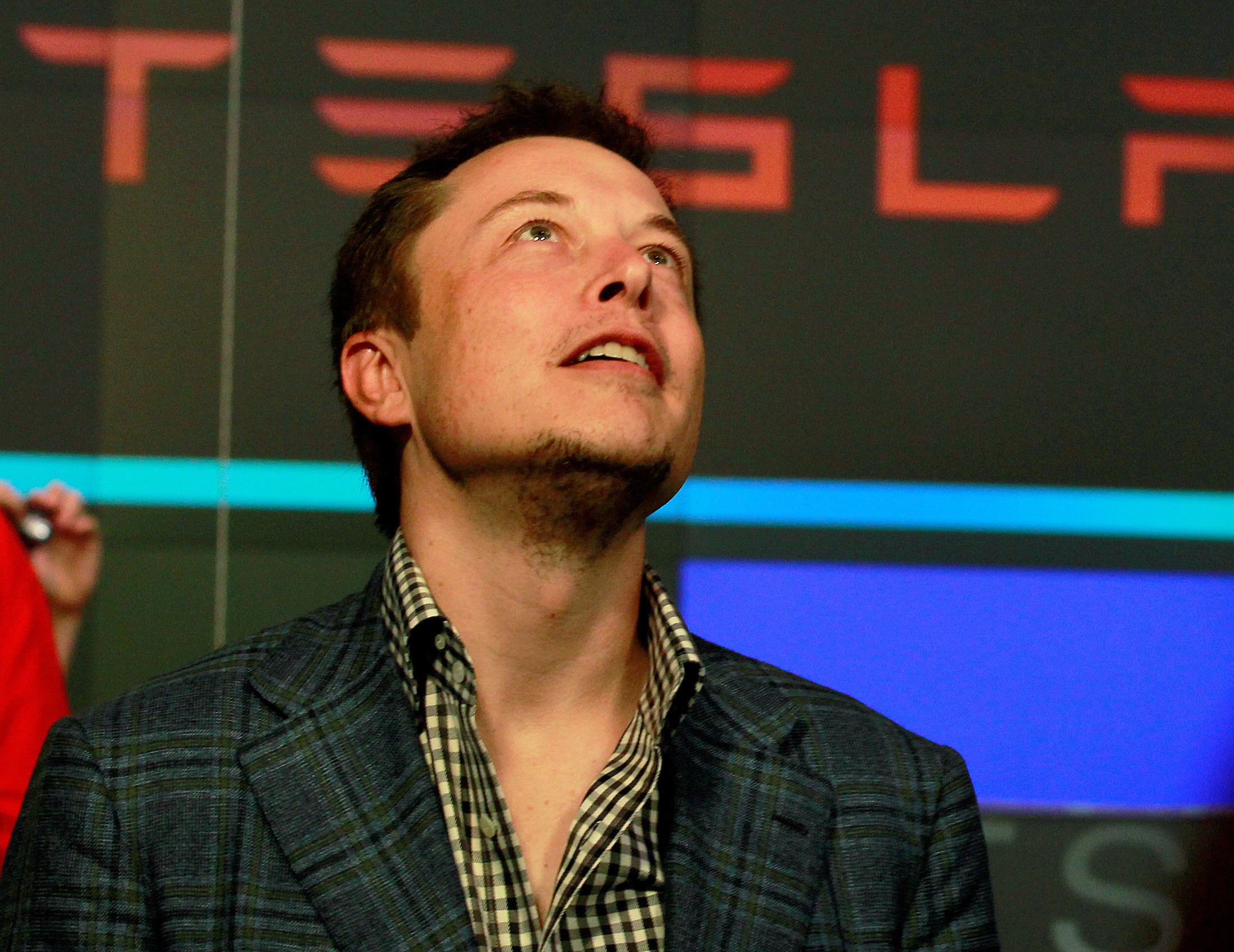 CEO of Tesla Motors Elon Musk reacts following the company's initial public offering at the NASDAQ market in New York June 29, 2010. REUTERS/Brendan McDermid//File Photo/File Photo