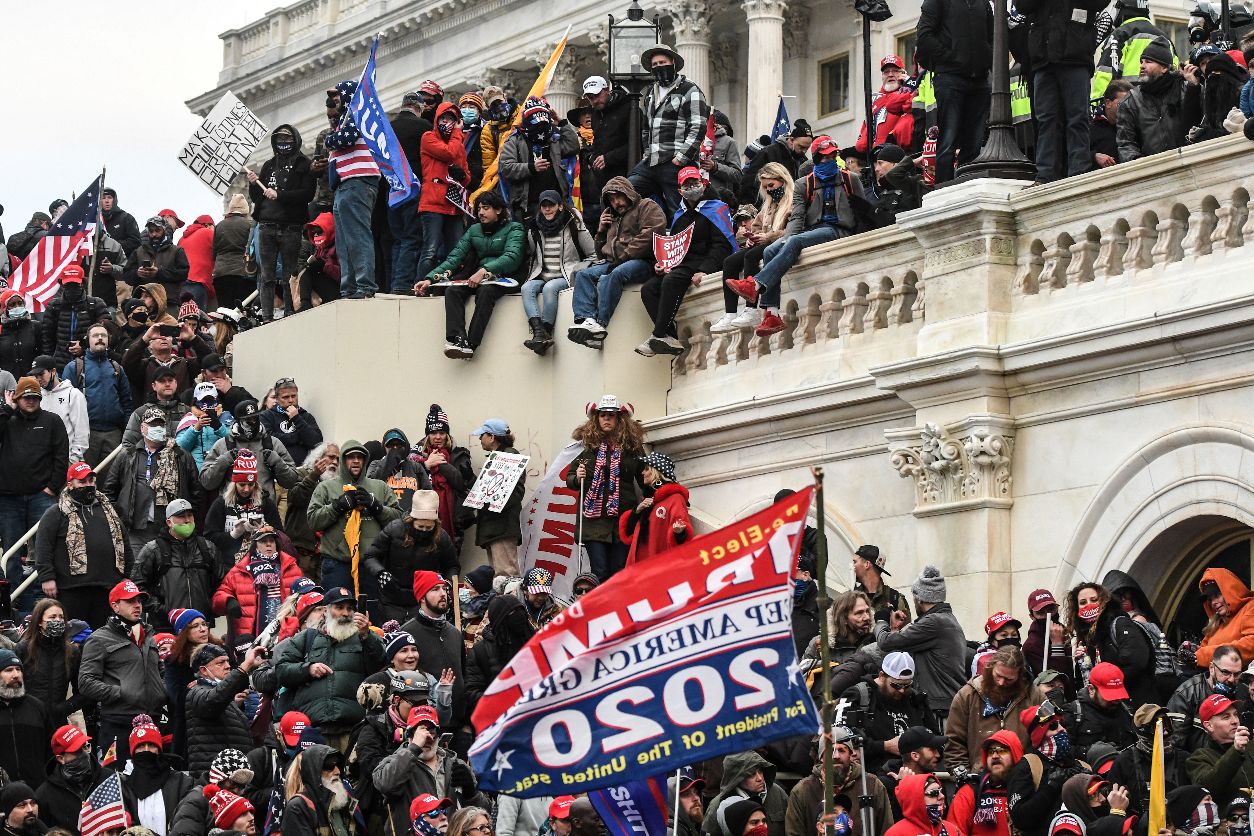 Supporters of U.S. President Donald Trump gather at the west entrance of the Capitol during a