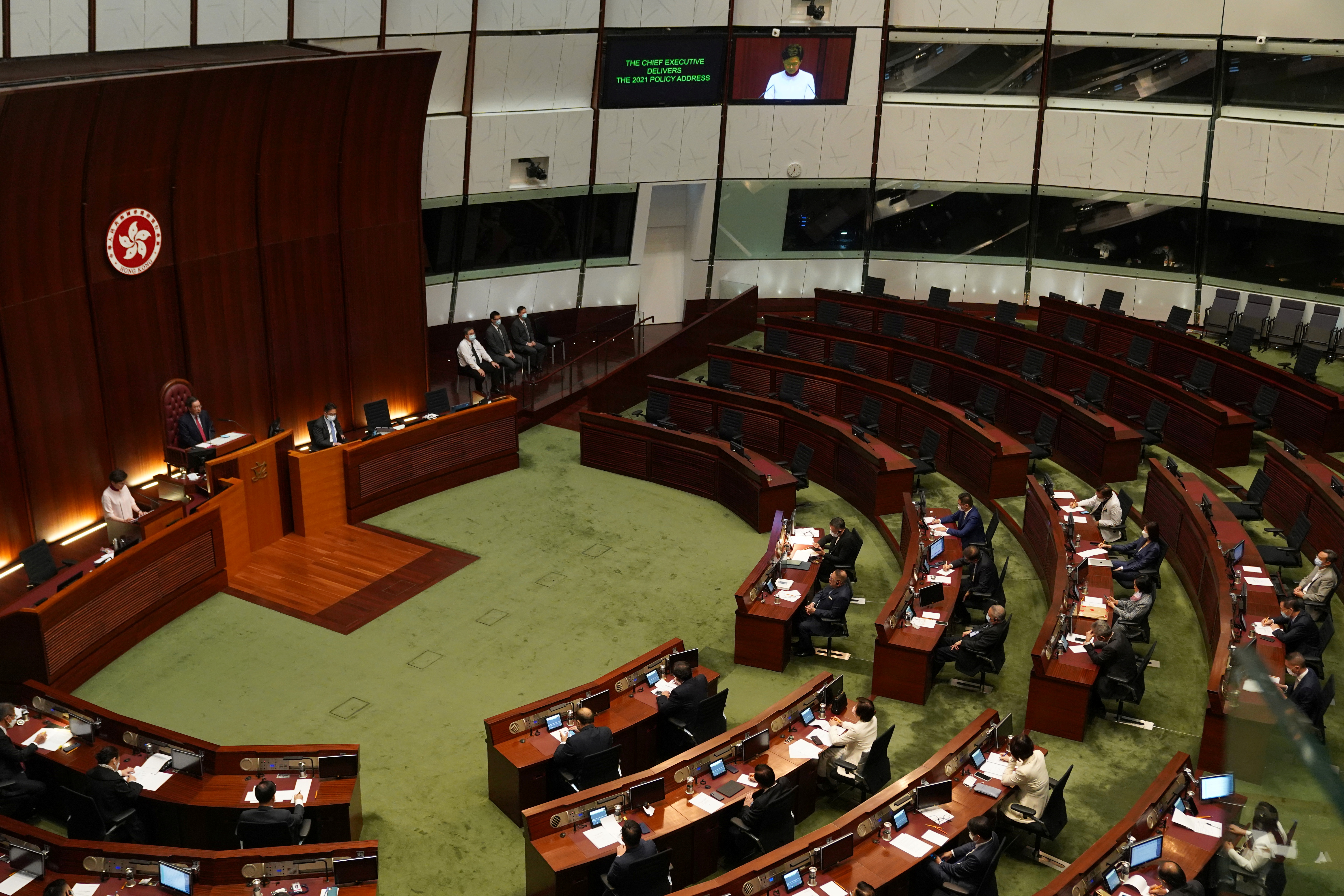 Empty seats of pro-democracy lawmakers are seen as Hong Kong Chief Executive Carrie Lam delivers her annual policy address at the Legislative Council in Hong Kong, China October 6, 2021. REUTERS/Lam Yik