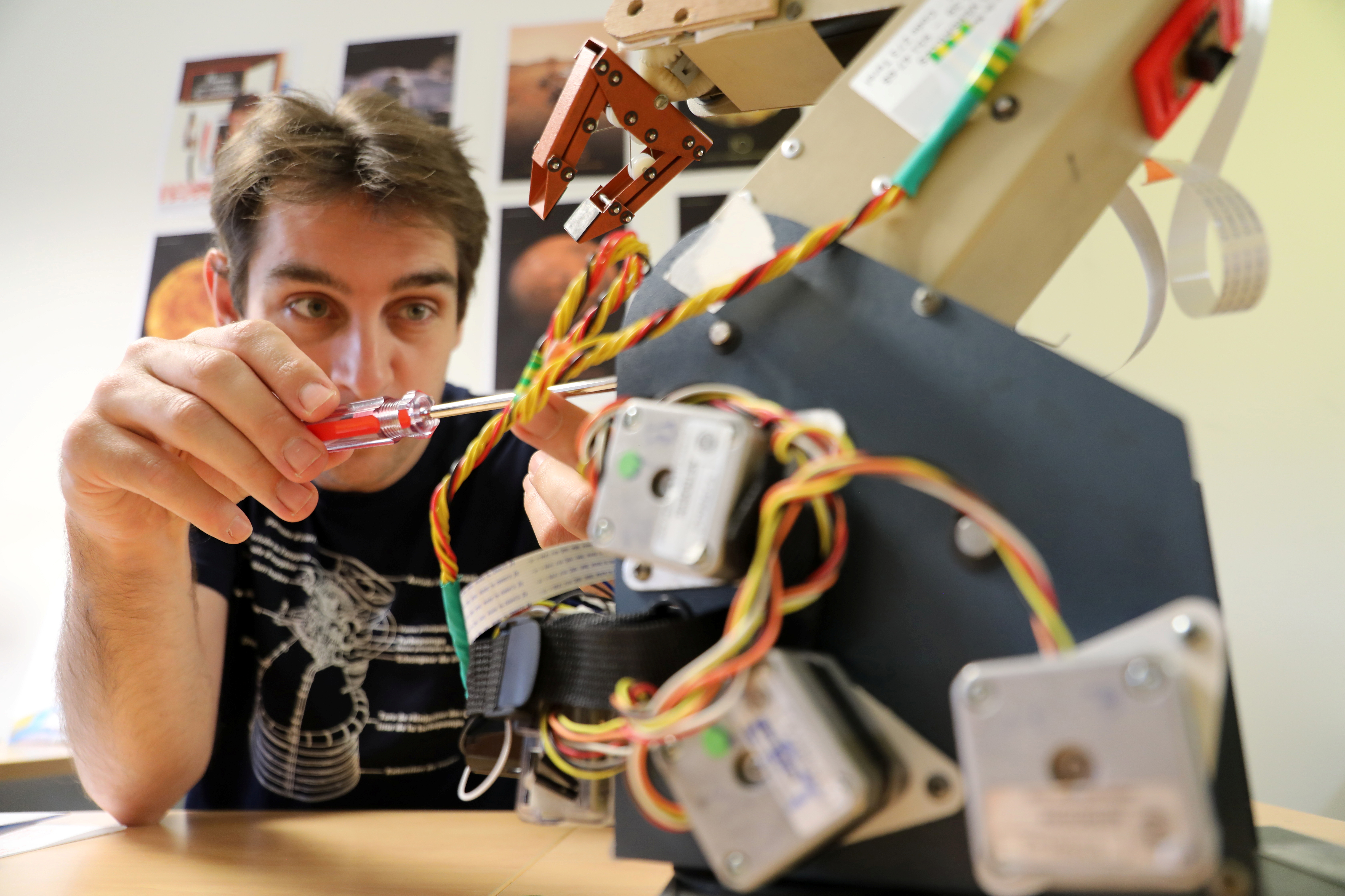 Matthieu Pluvinage, a candidate to the European Space Agency (ESA) astronaut selection, poses in his office at the ESIGELEC engineering school where he teaches, in Saint-Etienne-du-Rouvray, France, June 4, 2021. Picture taken June 4, 2021. REUTERS/Lea Guedj
