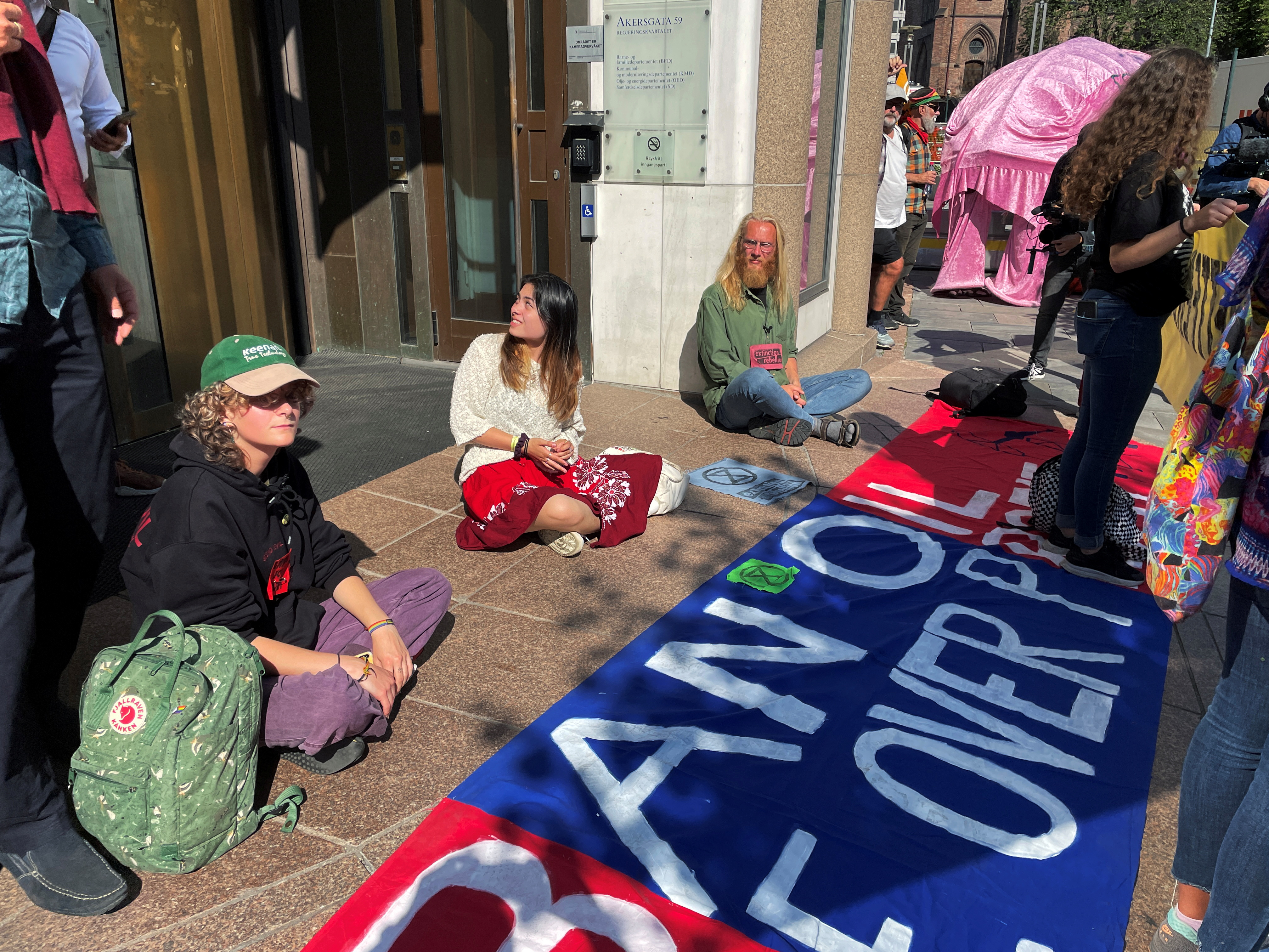 Extinction Rebellion protesters demonstrate at the Norwegian oil and energy ministry in Oslo, Norway August 23, 2021. REUTERS/Gwladys Fouche