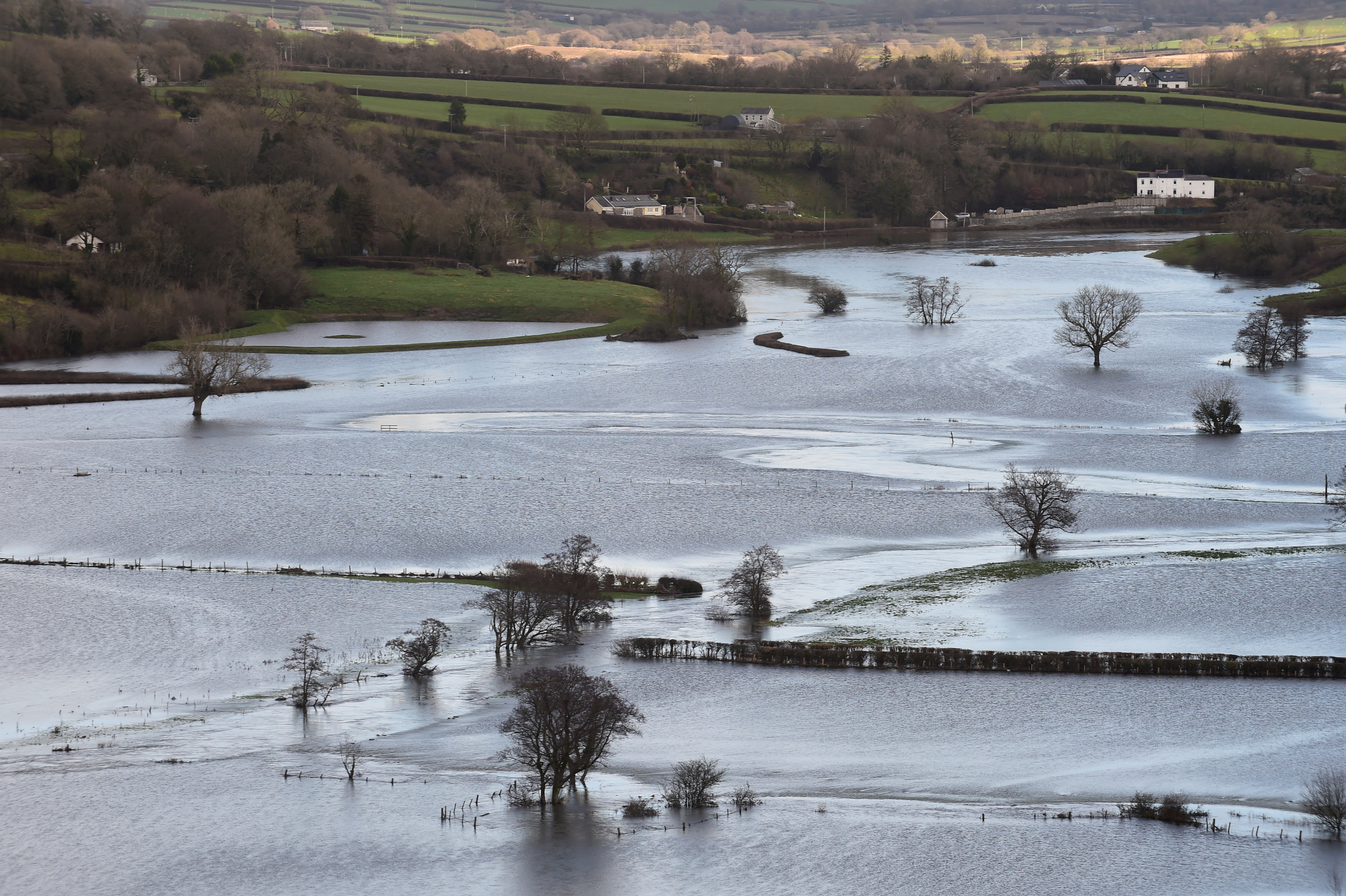 Flooded fields are seen after Storm Christoph hit Wales bringing torrential rain and floods, near Carmarthen, Wales, Britain January 21, 2021. REUTERS/Rebecca Naden