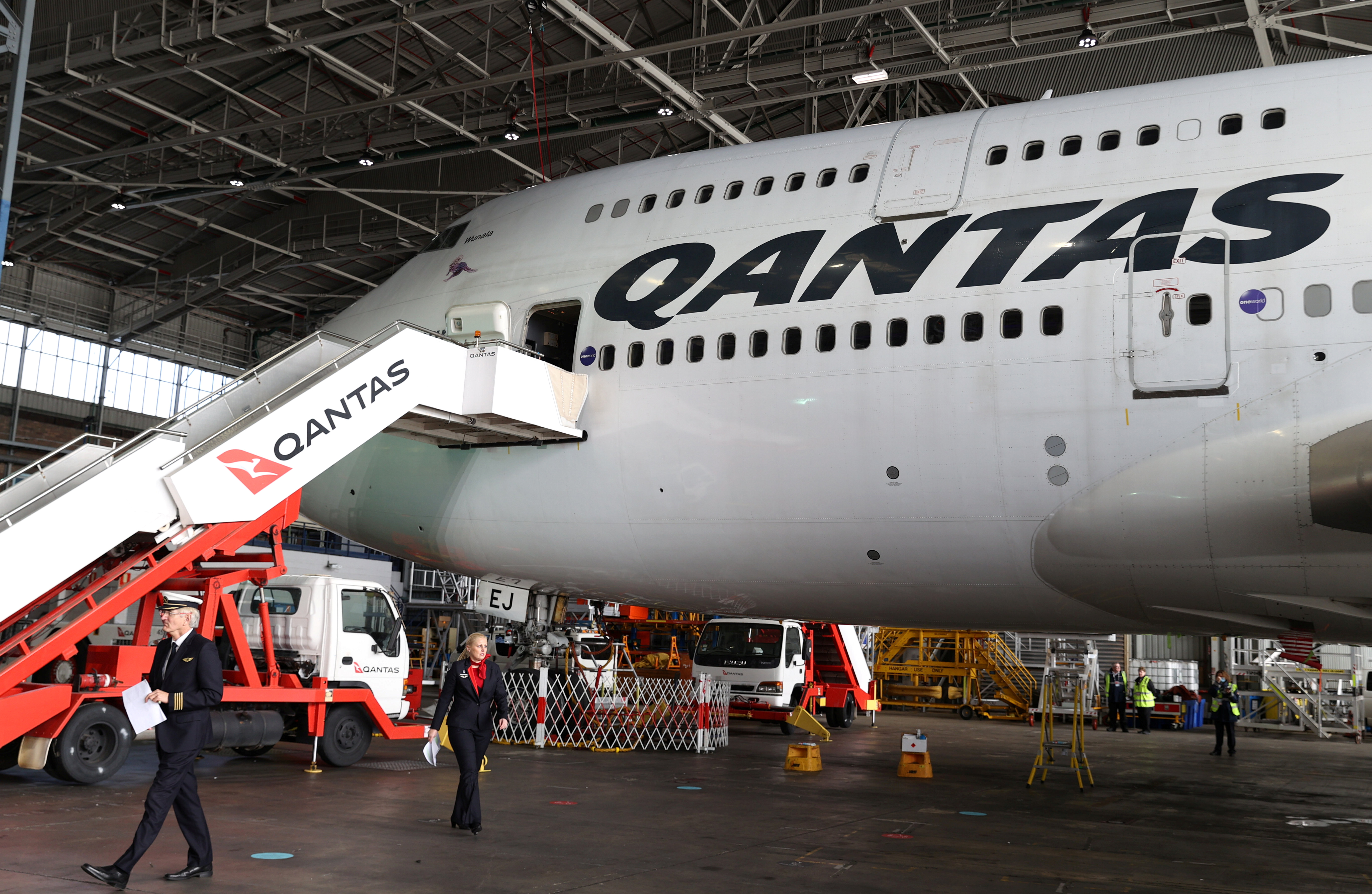 Qantas, which is retiring its remaining Boeing 747 planes early due to the coronavirus disease (COVID-19) pandemic, celebrates the departure of its last 747 jumbo jet from the Sydney Airport in Sydney, Australia, July 22, 2020.  REUTERS/Loren Elliott