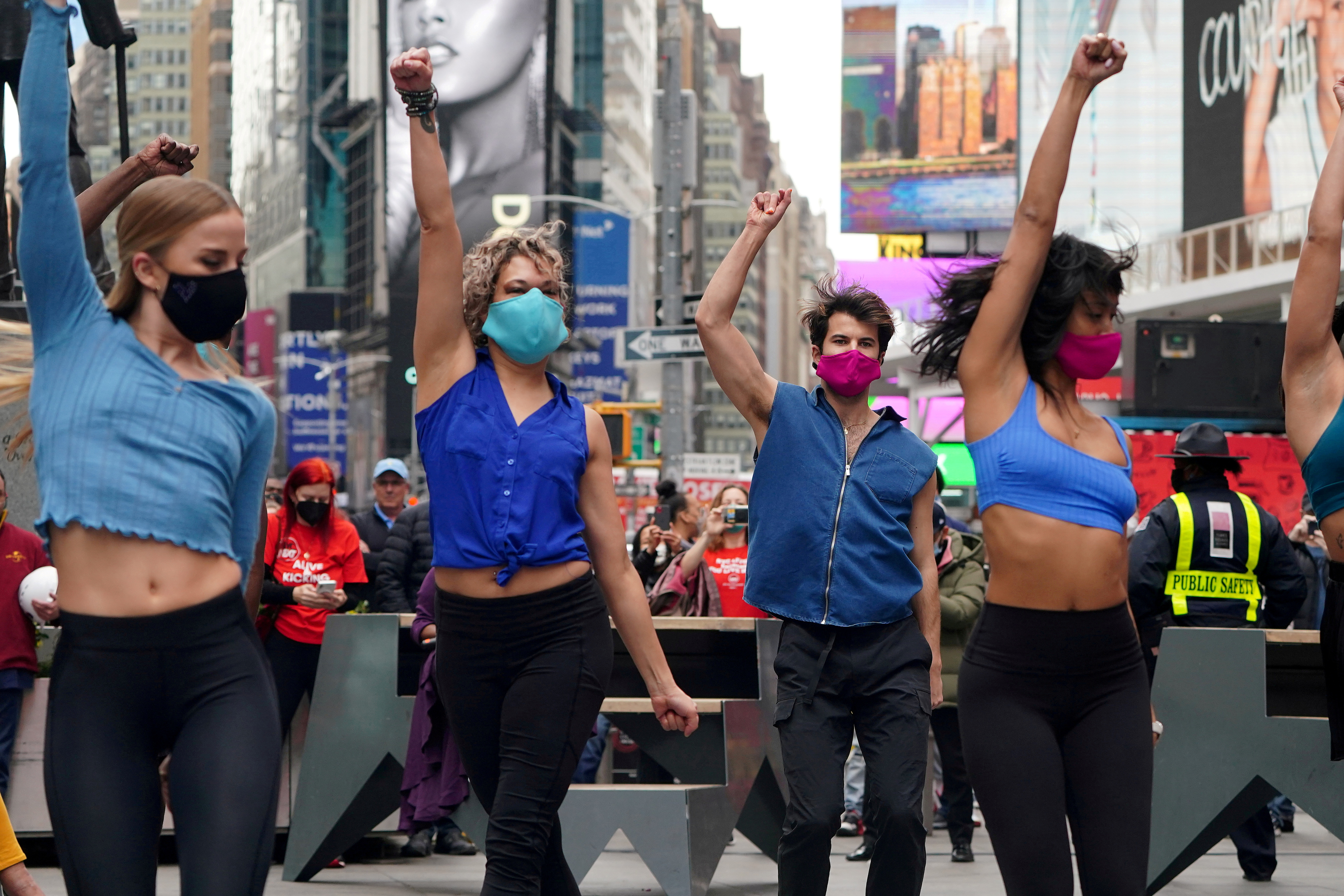 Performers take part in a pop up Broadway performance in anticipation of Broadway reopening in Times Square amid the coronavirus disease (COVID-19) pandemic in the Manhattan borough of New York City, New York, U.S., March 12, 2021. REUTERS/Carlo Allegri