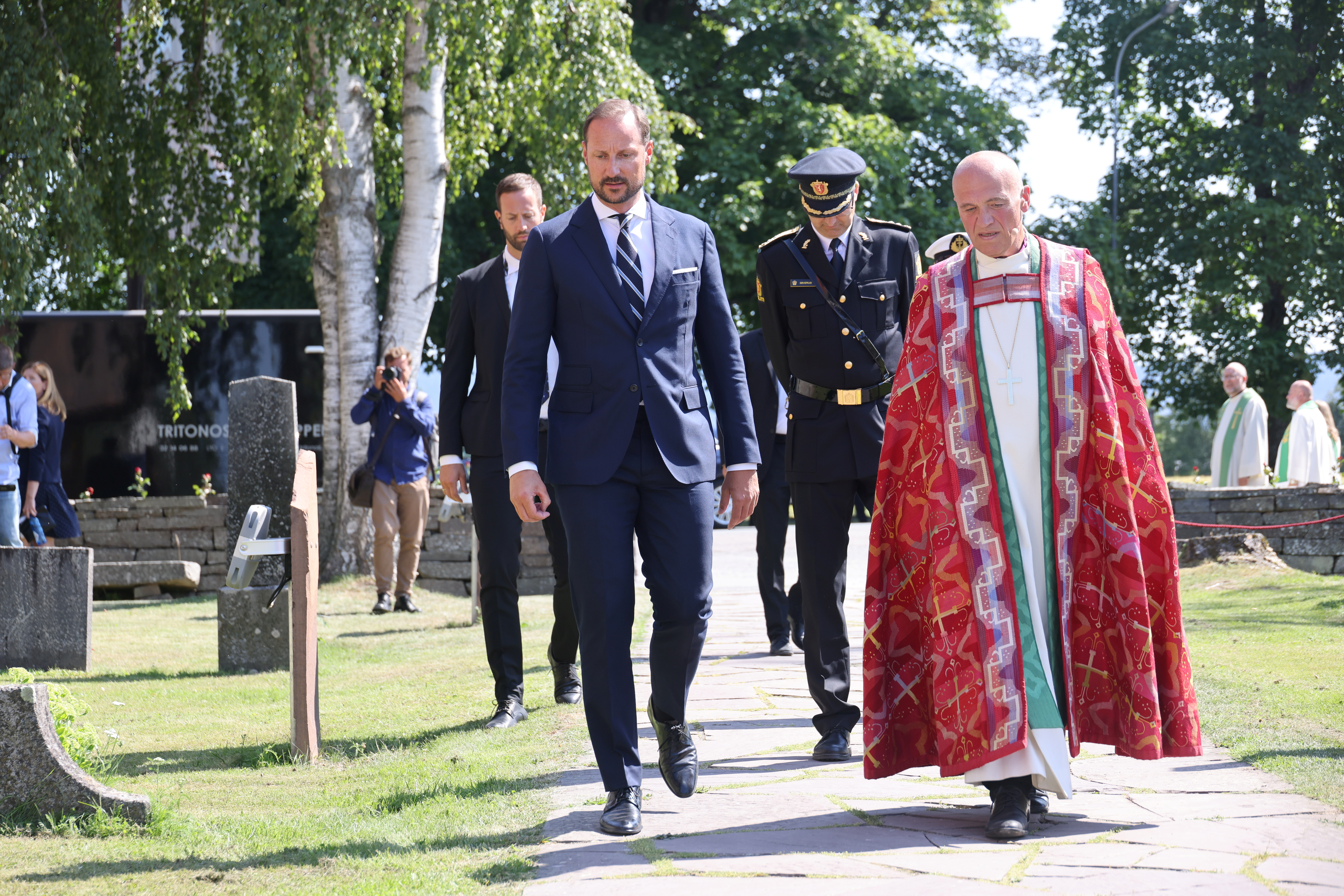 Norway's Crown Prince Haakon and bishop Jan Otto Myrseth walk as a memorial service takes place at Hole Church ten years after the Oslo and Utoeya island bomb attack, in Hole municipality, Norway, July 22, 2021. NTB/Geir Olsen/via REUTERS