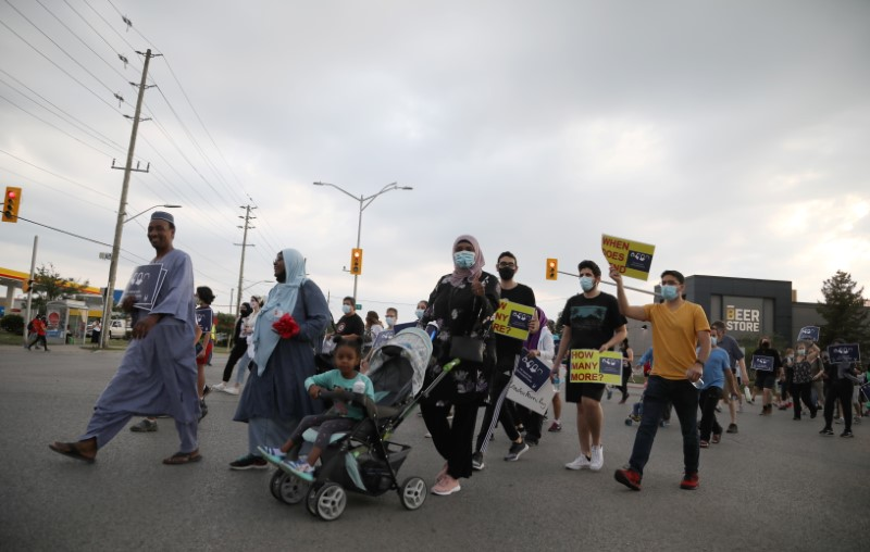 People march the 7km from a crime scene to a mosque in memory of a Muslim family that was killed in what police call a hate-motivated attack in London, Ontario, Canada June 11, 2021. REUTERS/Carlos Osorio