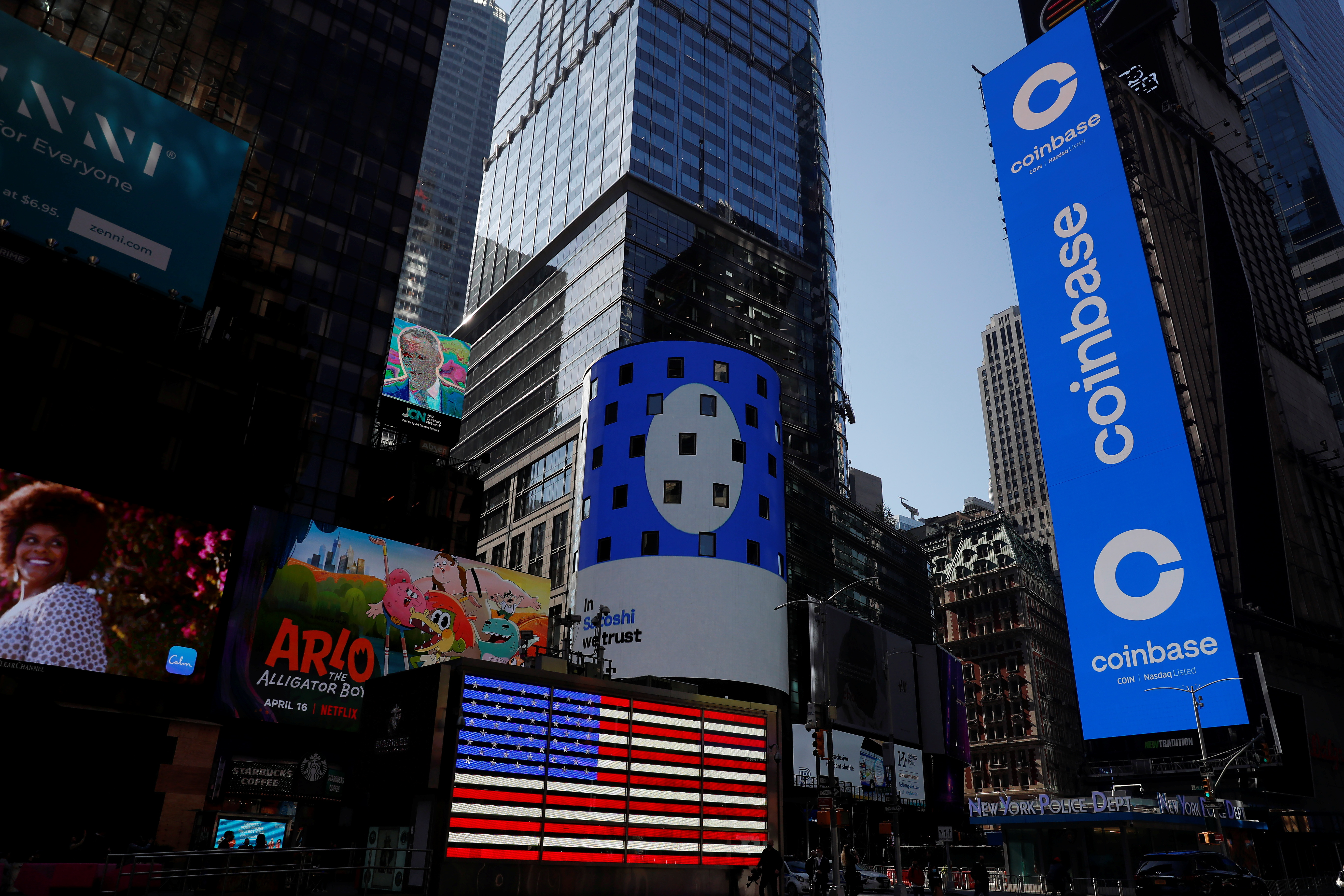 File photo: The logo for Coinbase Global Inc, the biggest U.S. cryptocurrency exchange, is displayed on the Nasdaq MarketSite jumbotron and others at Times Square in New York, U.S., April 14, 2021. REUTERS/Shannon Stapleton.