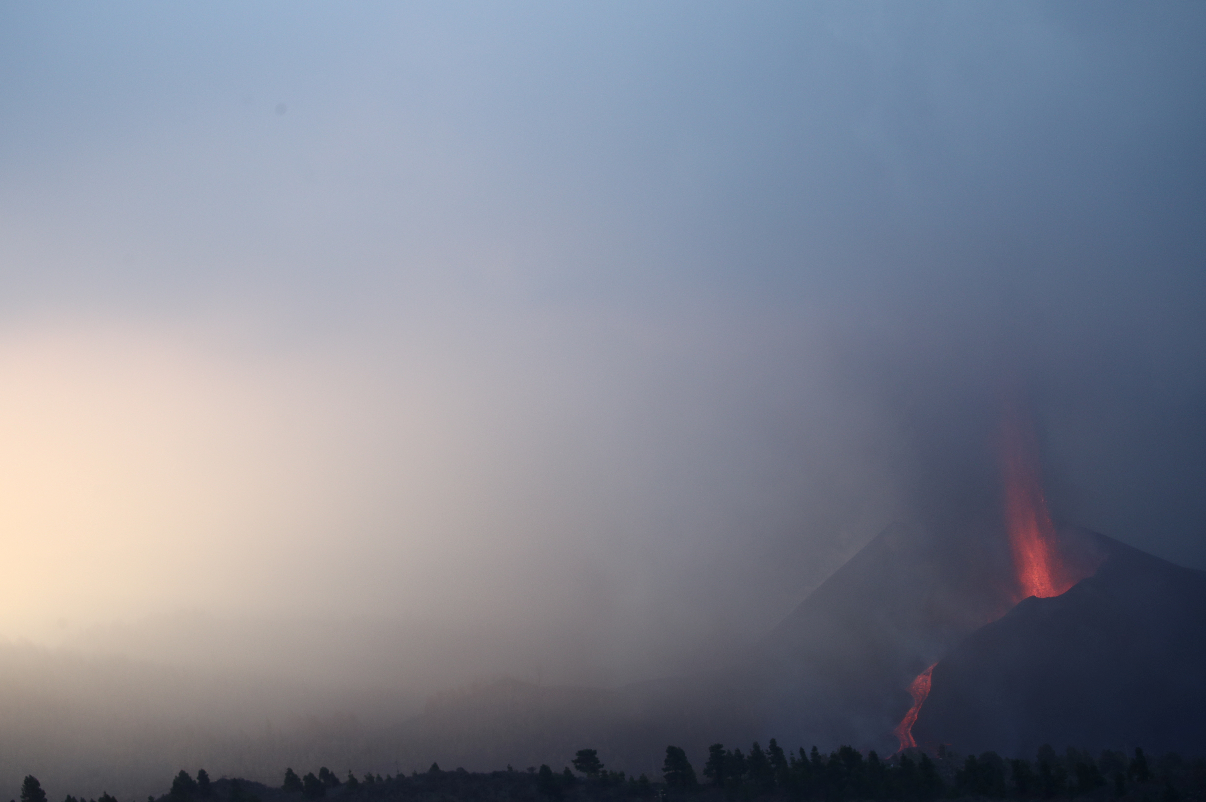 The Cumbre Vieja volcano spews lava and smoke as it continues to erupt on the Canary Island of La Palma, as seen from Tajuya, Spain, October 11, 2021. REUTERS/Sergio Perez
