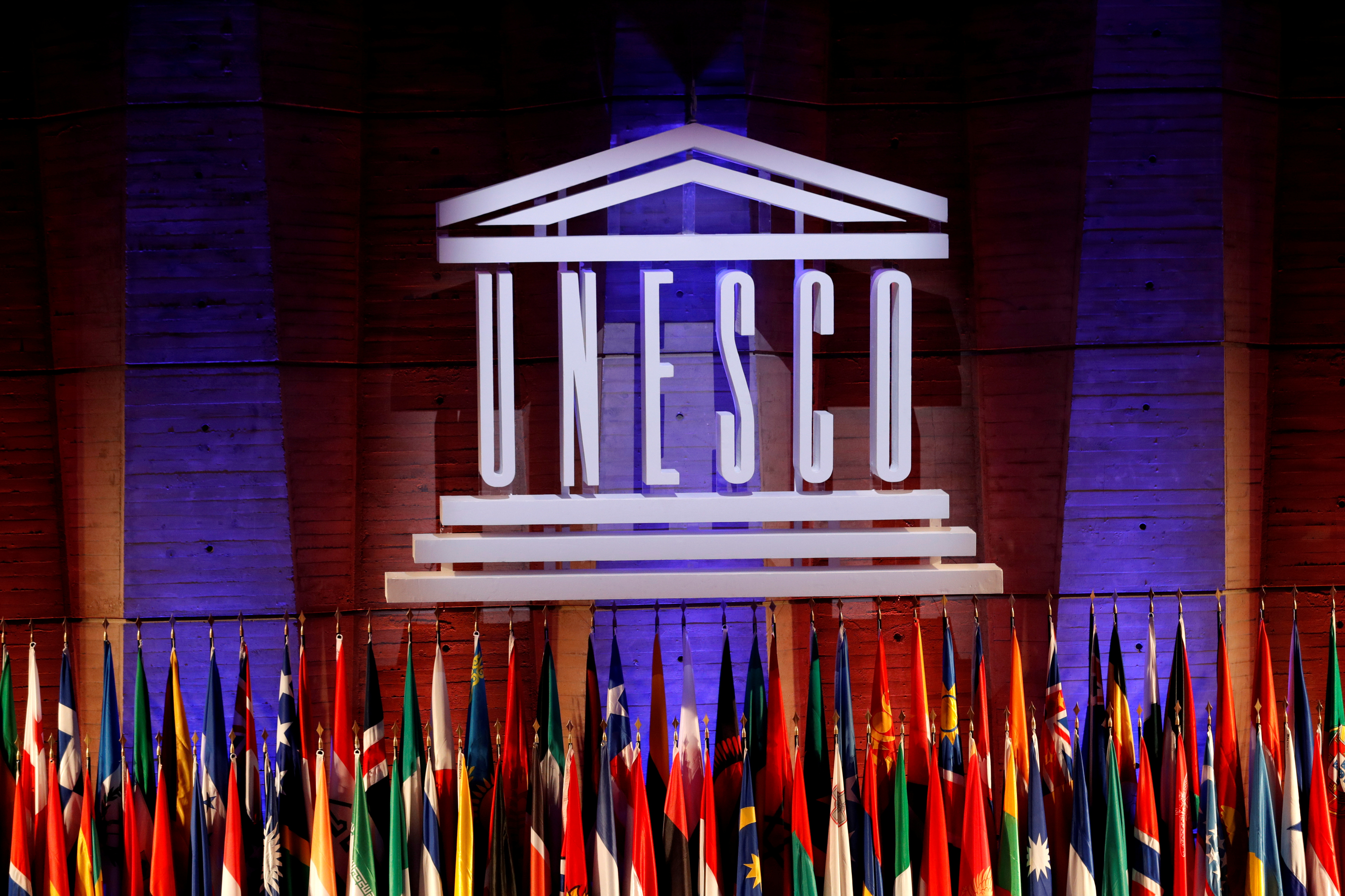 The UNESCO logo is seen during the opening of the 39th session of the General Conference of the United Nations Educational, Scientific and Cultural Organization (UNESCO) at their headquarters in Paris, France, October 30, 2017. REUTERS/Philippe Wojazer/File Photo