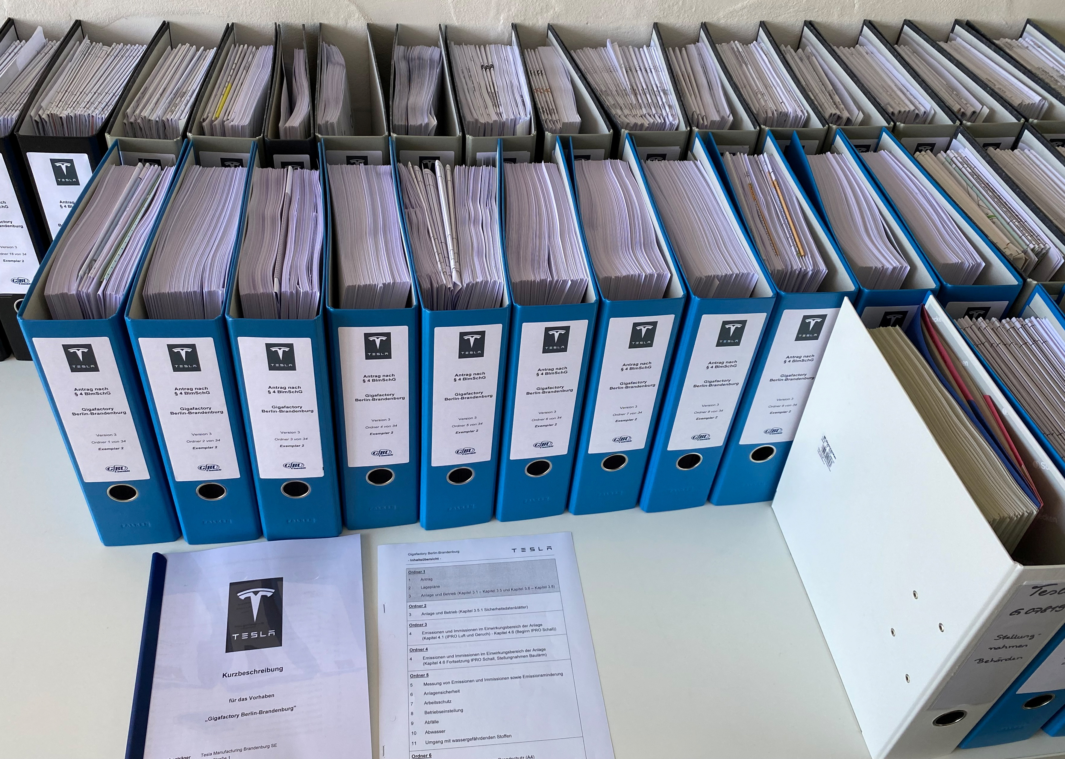 Files containing Tesla's application for its planned factory in Gruenheide, available for the public, are displayed in the townhall of Gruenheide near Berlin, Germany, June 18, 2021.  Picture taken June 18, 2021.    REUTERS/Nadine Schimroszik/Files