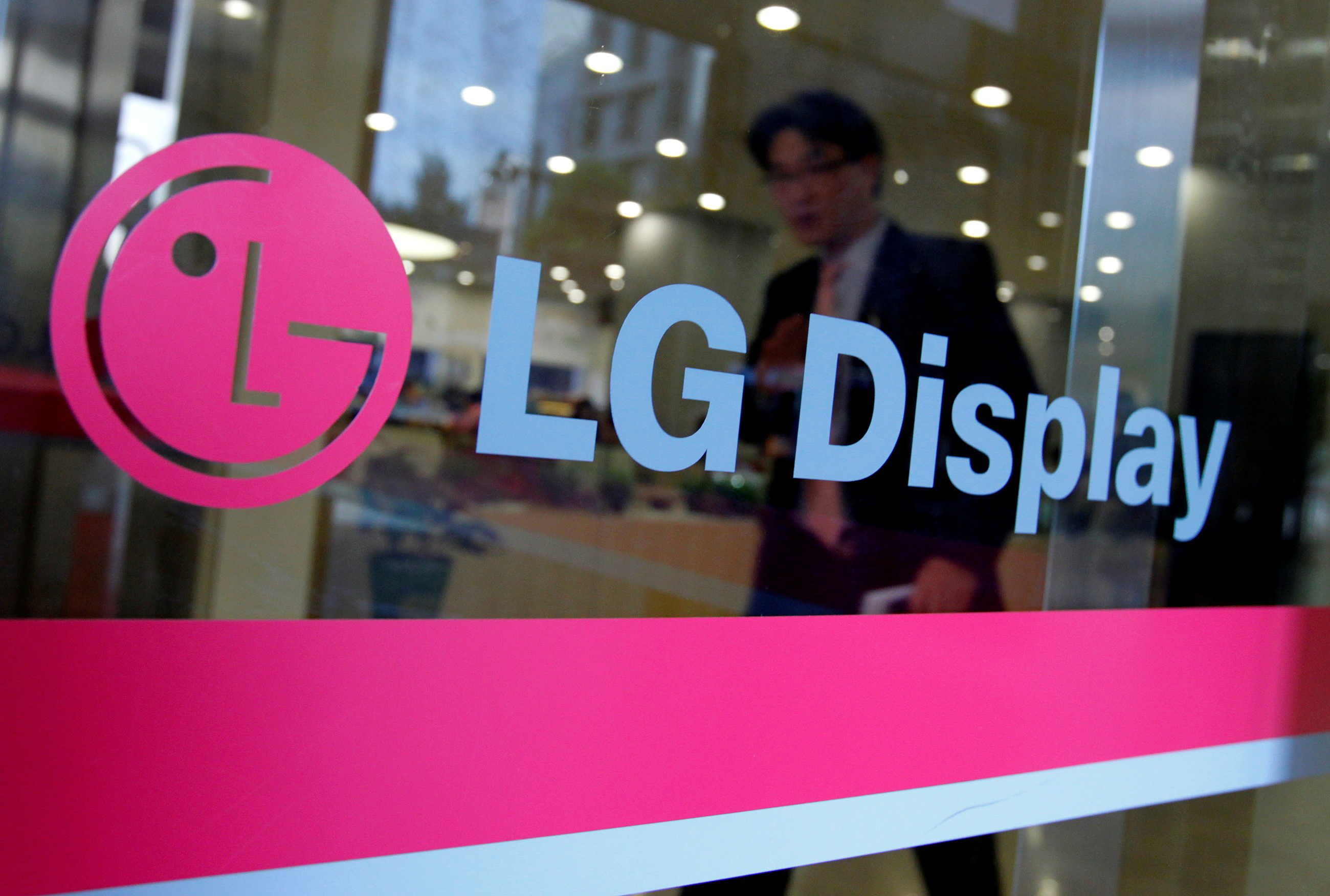 A man walks out of the headquarters of LG Display in Seoul, October 20, 2011.  REUTERS/Jo Yong-Hak/File Photo