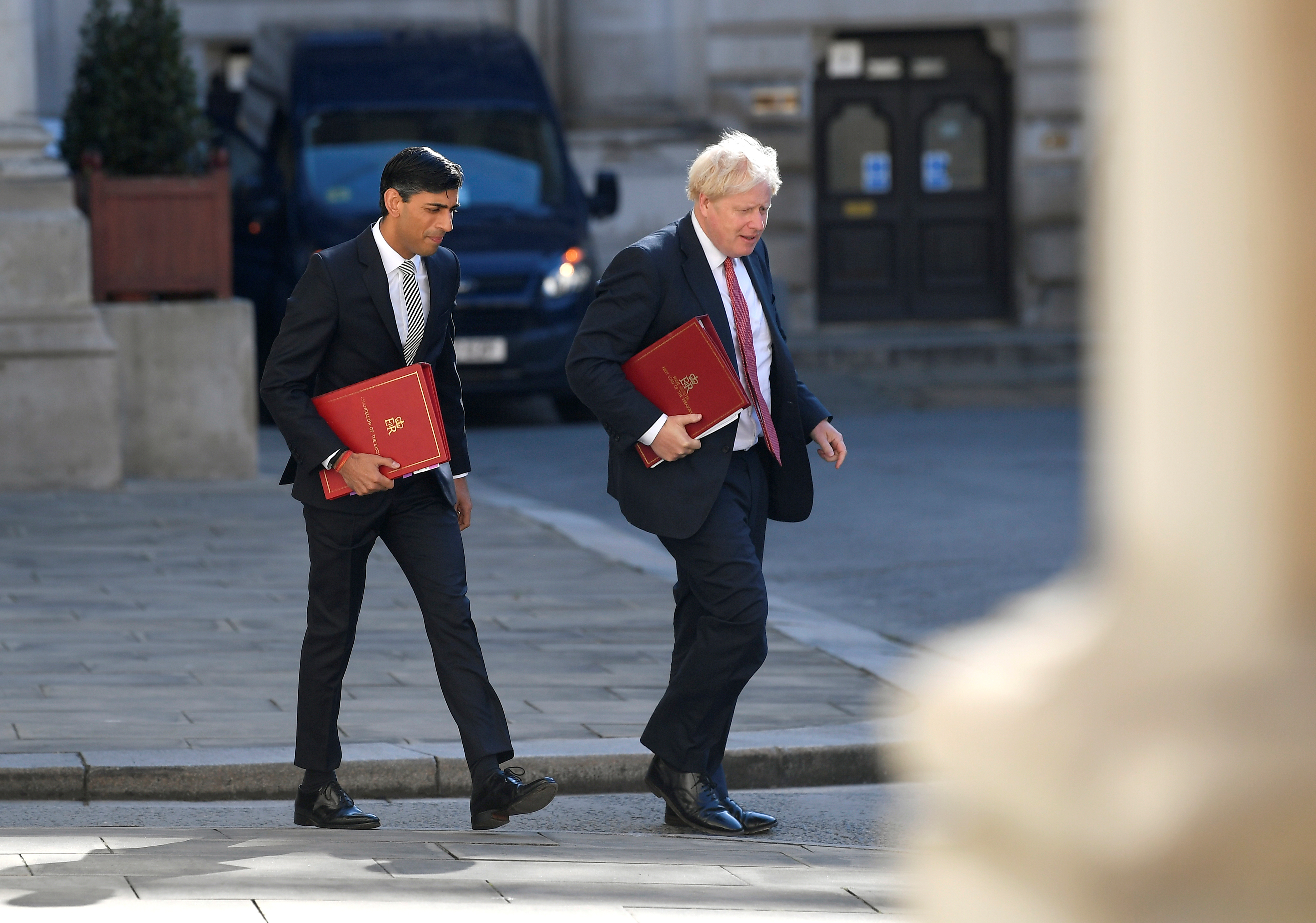Britain's Chancellor of the Exchequer Rishi Sunak and Britain's Prime Minister Boris Johnson arrive to attend a Cabinet meeting of senior government ministers at the Foreign and Commonwealth Office (FCO) in London, Britain, September 1, 2020. REUTERS/Toby Melville/Pool