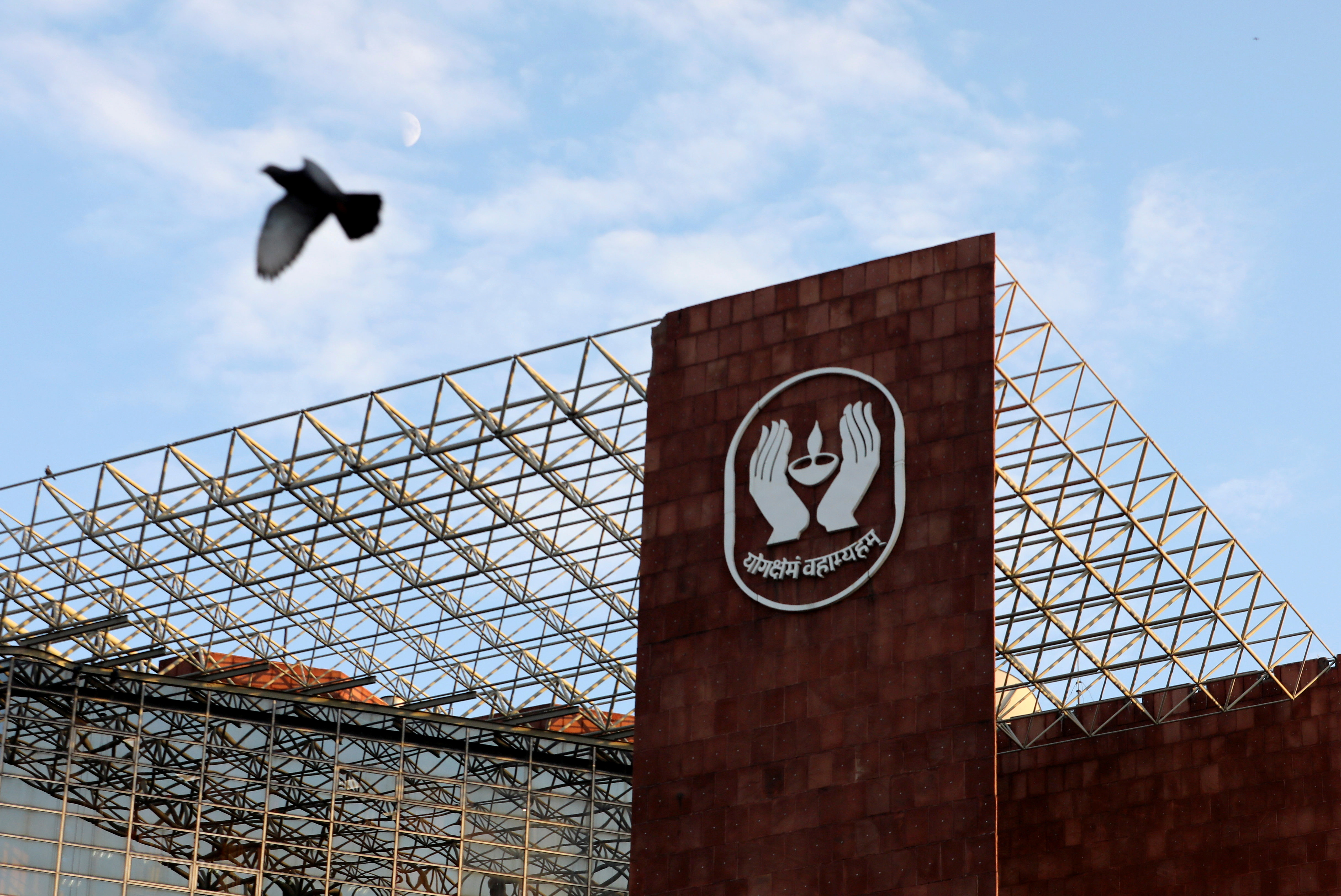 A bird flies past the logo of Life Insurance Corporation of India (LIC) at one of its offices in New Delhi, India September 14, 2021.  REUTERS/Anushree Fadnavis/File Photo